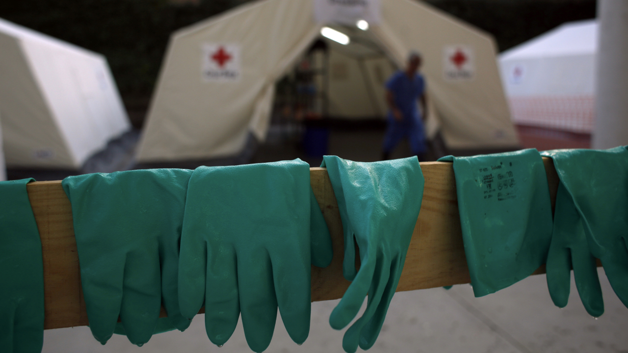 Gloves are left to dry after an Ebola training session held by Spain's Red Cross in Madrid October 29, 2014. The Spanish Red Cross is training doctors, nurses and engineers to fight Ebola in Western Africa during a two day pre-deployment course at a mock field hospital resembling the Ebola treatment center the organization has in Kenema, Sierra Leone. REUTERS/Susana Vera (SPAIN - Tags: HEALTH SOCIETY) - GM1EAAU0FM601