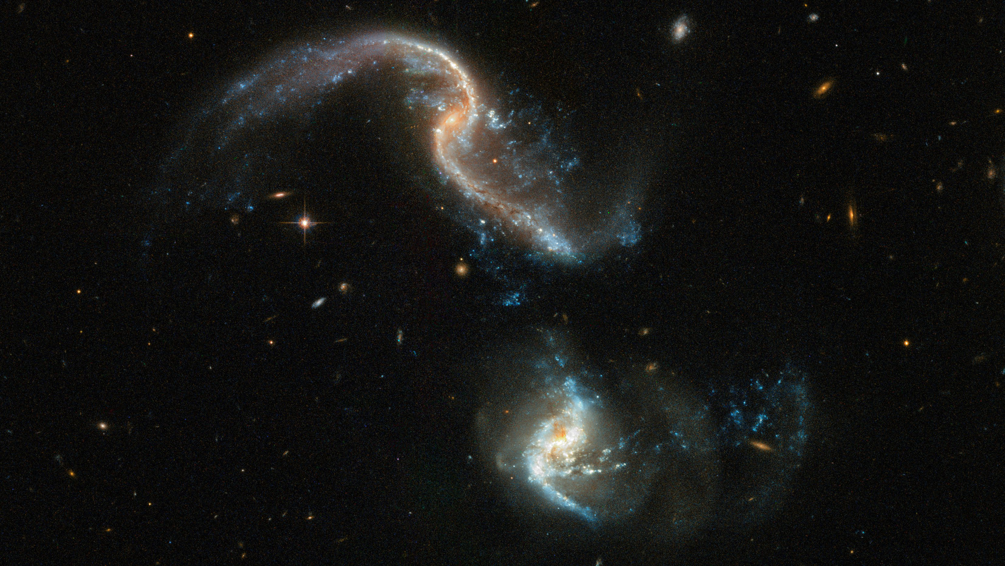 Photos: The Hubble Space telescope captured two galaxies ...