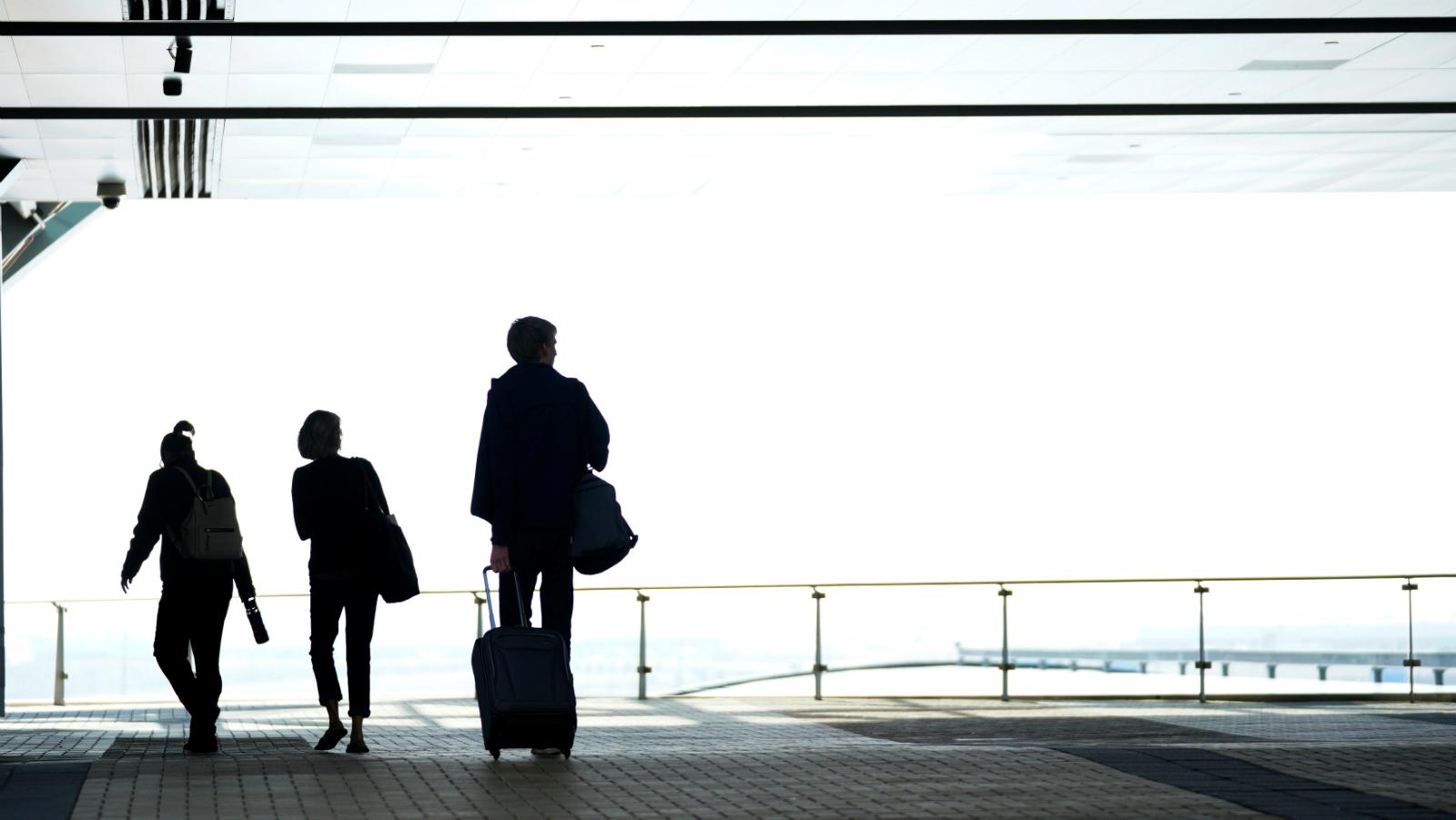 Travelers enter the airport hotel at Denver International Airport in Denver, Colorado, U.S. November 3, 2017.