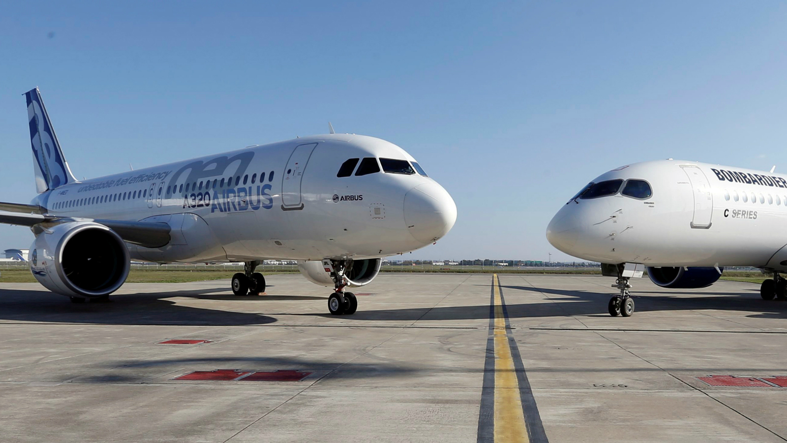 An Airbus A320neo aircraft and a Bombardier CSeries aircraft are pictured during a news conference to announce a partnership between Airbus and Bombardier on the C Series aircraft programme, in Colomiers near Toulouse, France, October 17, 2017.
