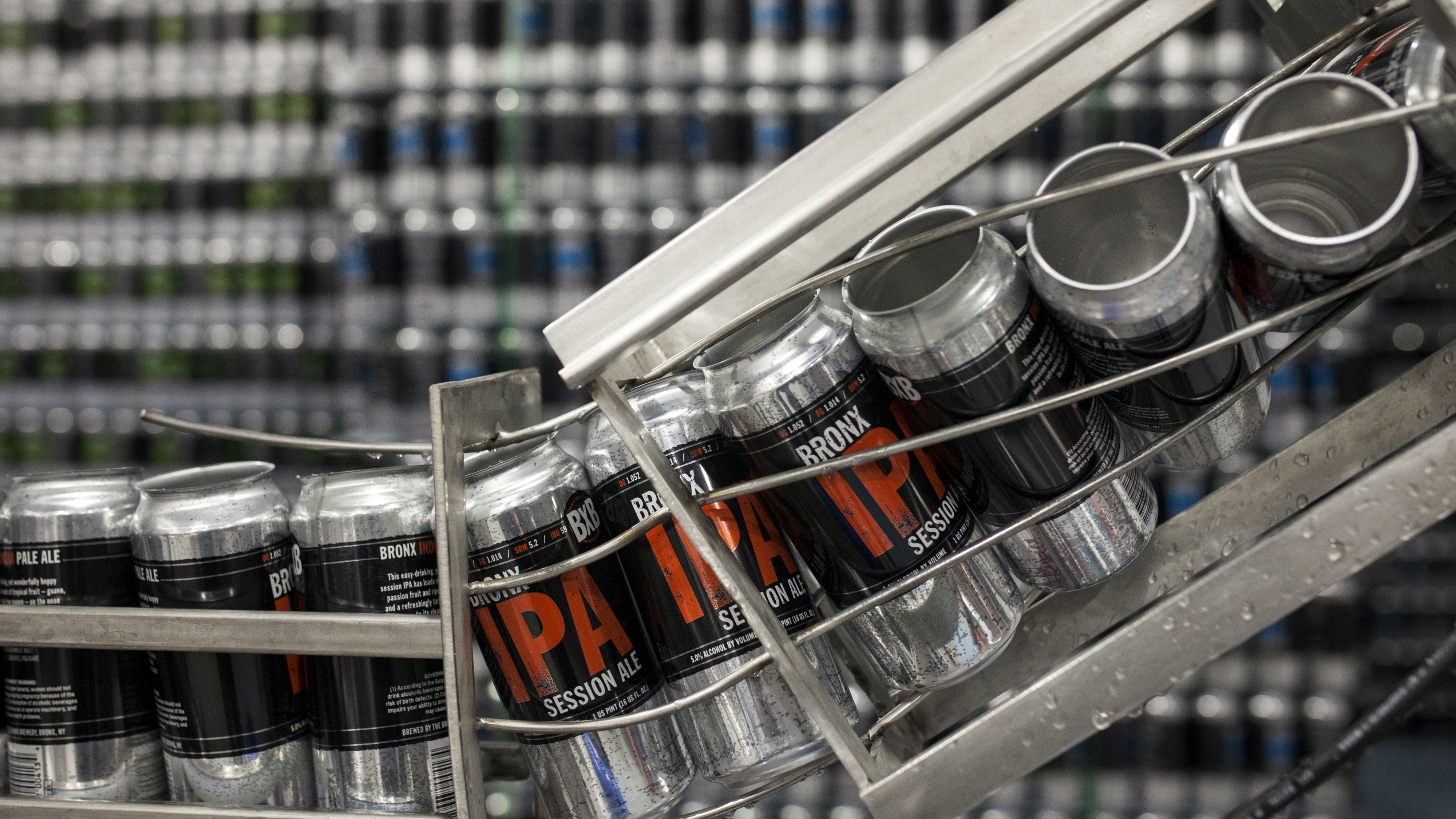 Empty cans wait to be filled with Bronx IPA Session Ale beer at the Bronx Brewery in the Bronx borough of New York, United States, March 5, 2015. The popularity of craft beers has grown rapidly in recent years in the United States as drinkers seek new tastes, with sales estimated to have climbed more than a fifth in 2014. U.S. sales of craft beer in 2014 were worth nearly $20 billion, according to U.S. industry body the Brewers Association, up more than 22 percent from the previous year and accounting for nearly a fifth of all beer sold in the country. Picture taken March 5, 2015.