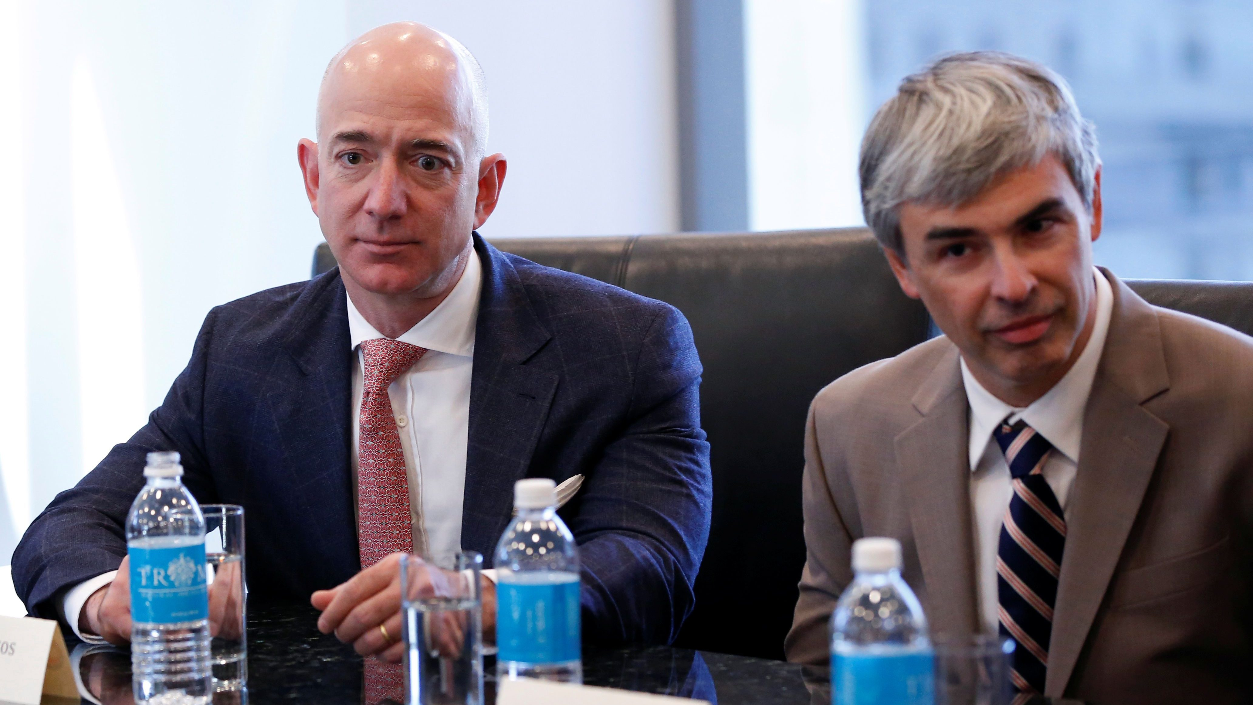 (L-R) Amazon CEO Jeff Bezos and Larry Page, CEO and Co-founder of Alphabet, sit during a meeting with U.S. President-elect Donald Trump and technology leaders at Trump Tower in New York, U.S., December 14, 2016. REUTERS/Shannon Stapleton - RC1E751AF050