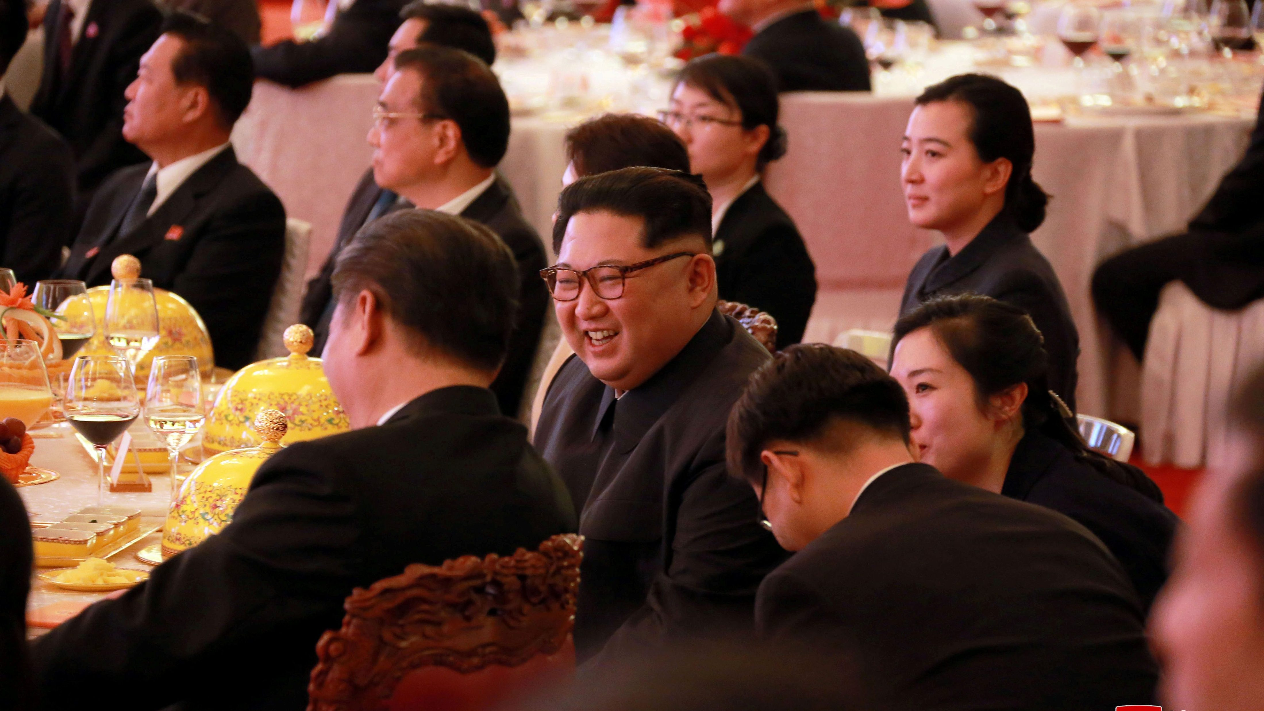 North Korean leader Kim Jong Un smiles during a banquet in Beijing, as he paid an unofficial visit to China, in this undated photo released by North Korea's Korean Central News Agency (KCNA) in Pyongyang March 28, 2018.