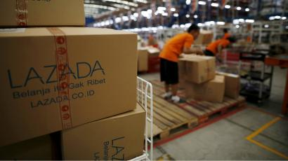 Employees at online retailer Lazada fill orders at the company's warehouse in Jakarta
