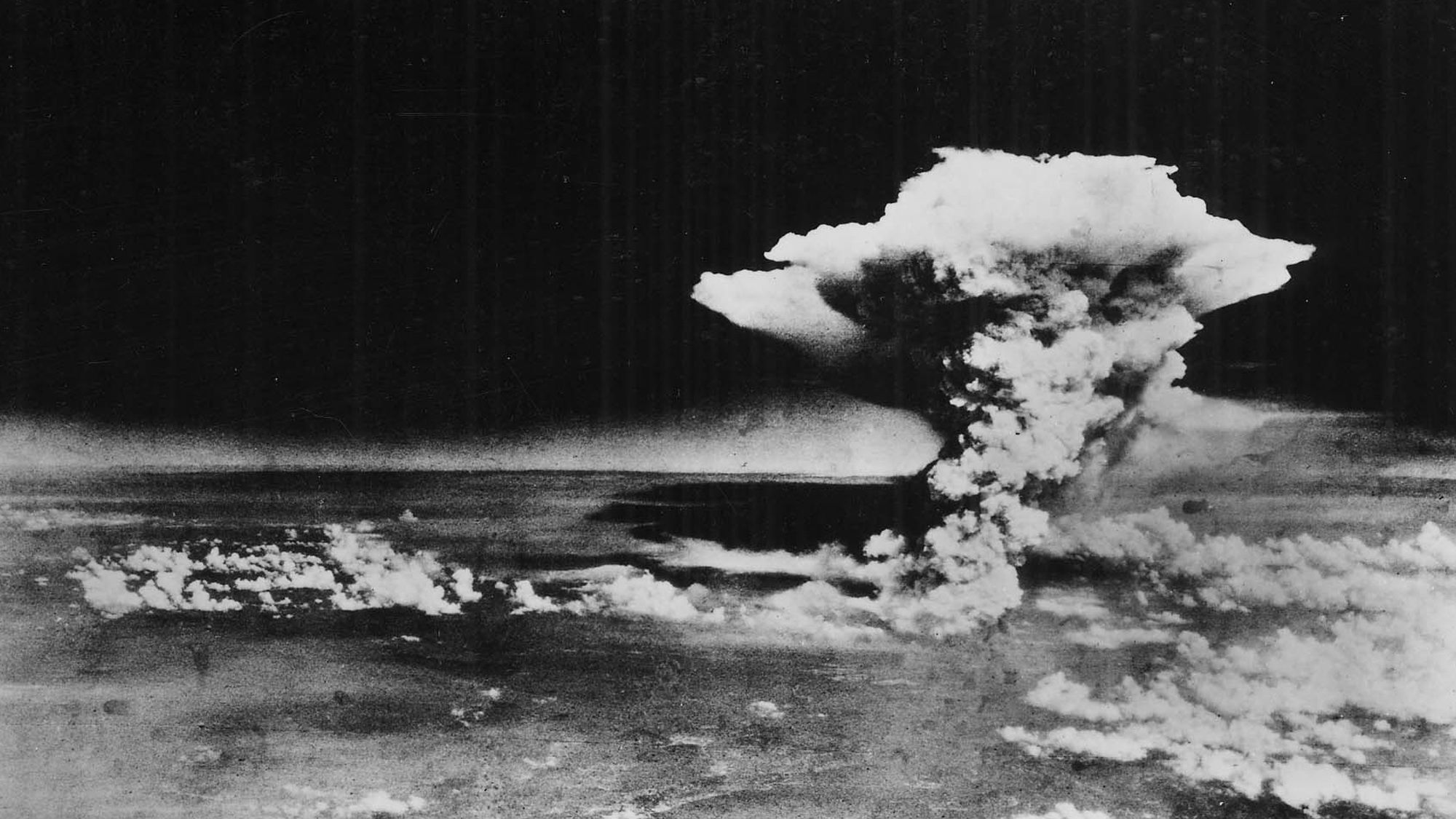 "In this Aug. 6, 1945, photo released by the U.S. Army and provided by the Hiroshima Peace Memorial Museum, a huge cloud resulting from the massive fires started by ""Little Boy"", the atomic bomb dropped on Hiroshima, Japan, is photographed from a reconnaissance plane a few hours after the initial explosion."