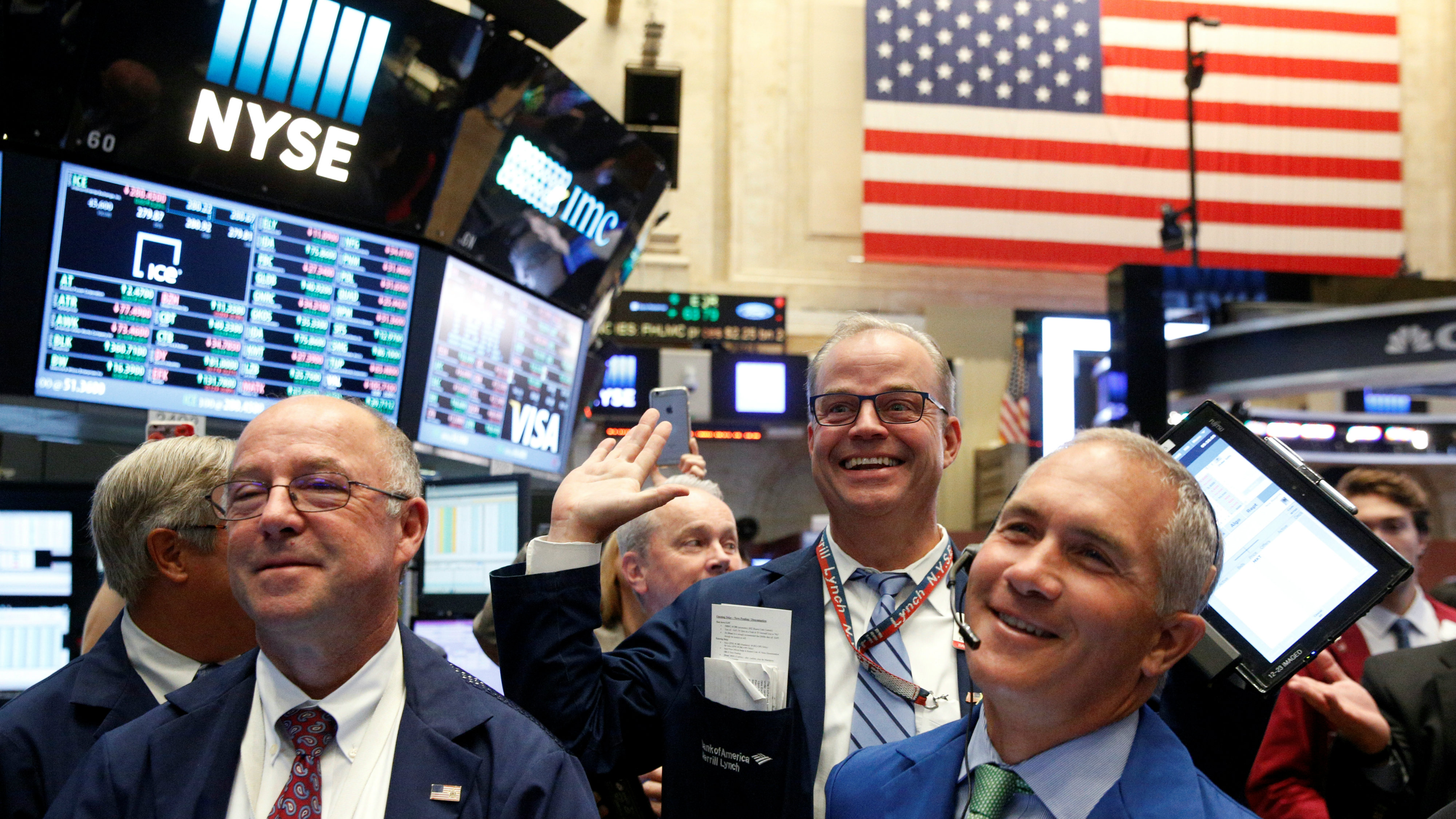Traders react while working on the floor of the New York Stock Exchange