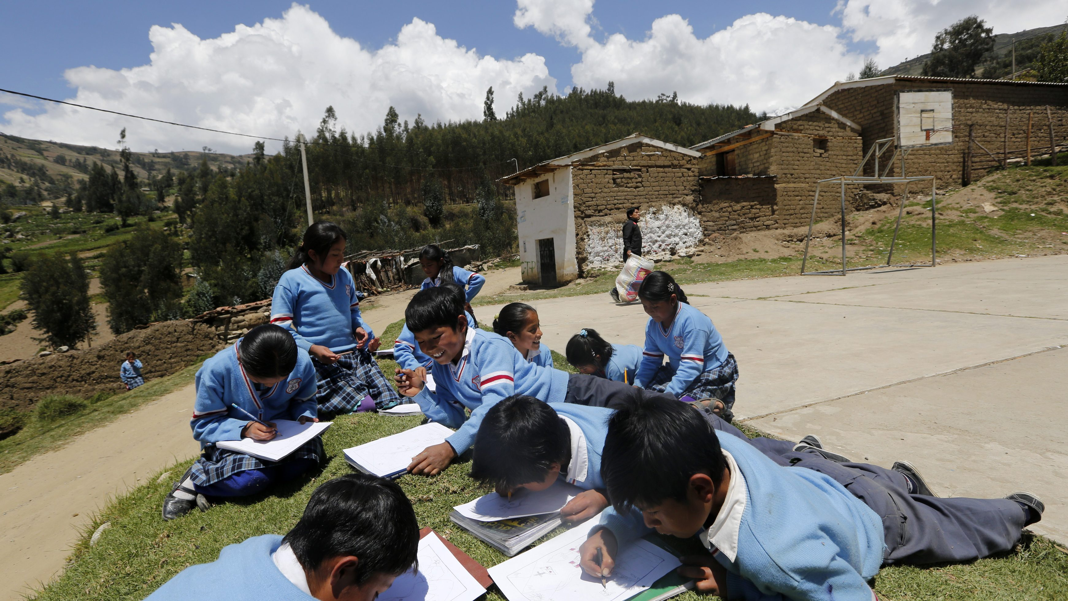 Students draw in a garden in Peru