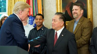 U.S. President Donald Trump shakes hands with Hock E. Tan, CEO of Broadcom as Trump delivered remarks about the situation of the jobs market in the Oval Office of the White House in Washington, U.S. November 2, 2017.