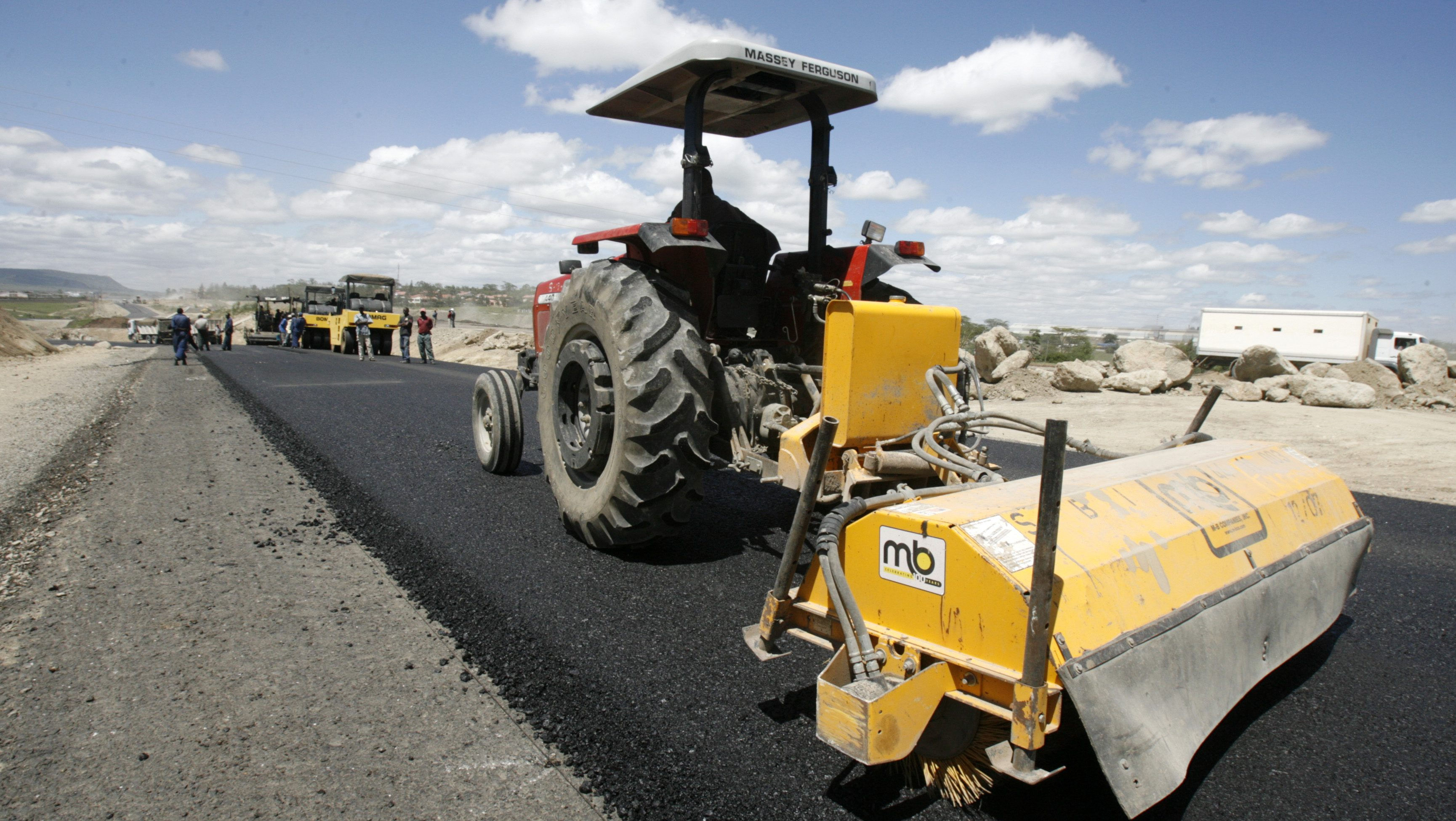 Contractors work on the Mombasa-Nairobi highway construction project in Athi River Kenya