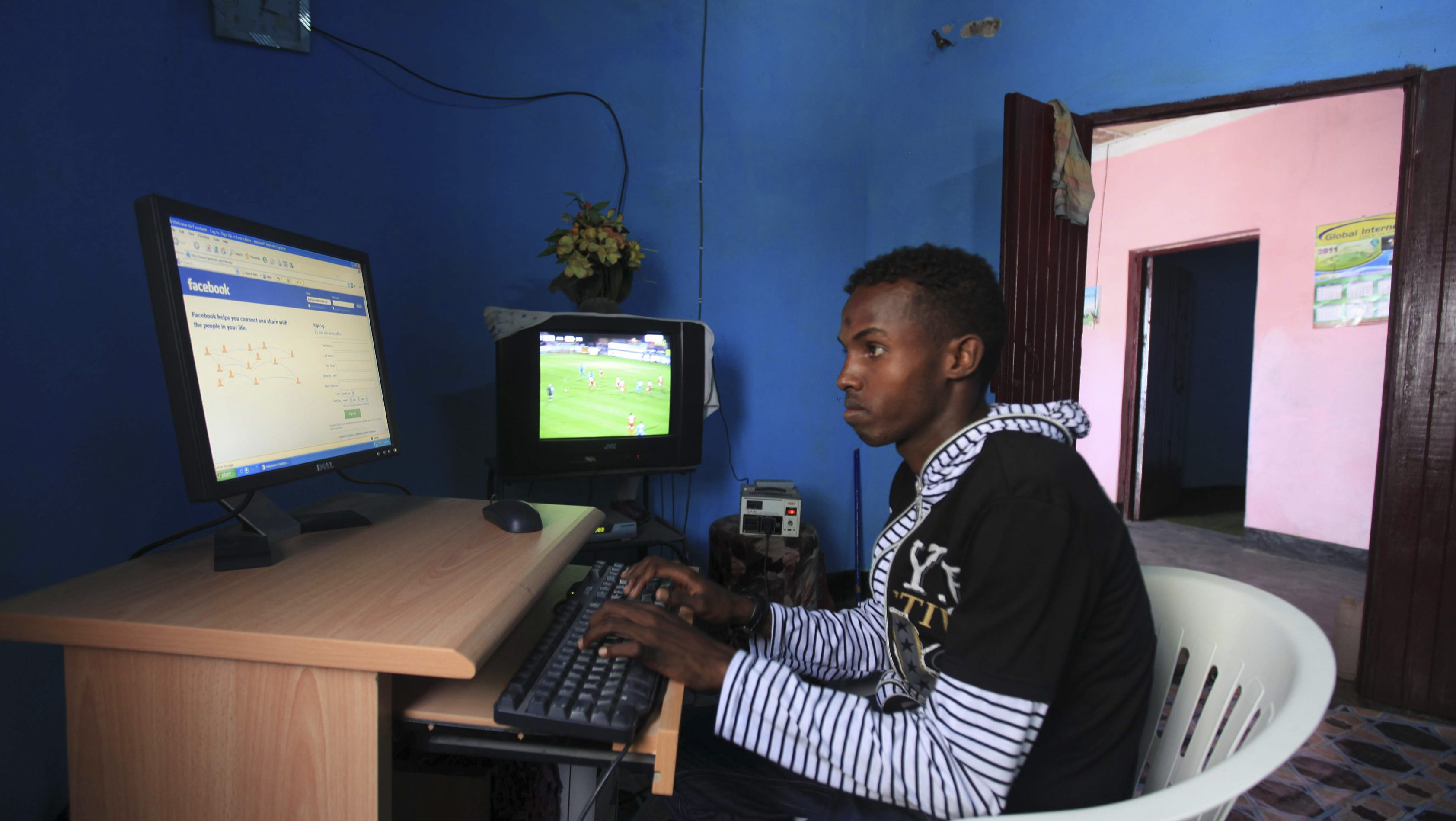 Somali athlete Abdullah Bare Kuulow browses the internet at a cyber-cafe after a training session as part of their preparations for the 2012 London Olympic Games in Somalia's capital Mogadishu March 14, 2012. Picture taken March 14, 2012.