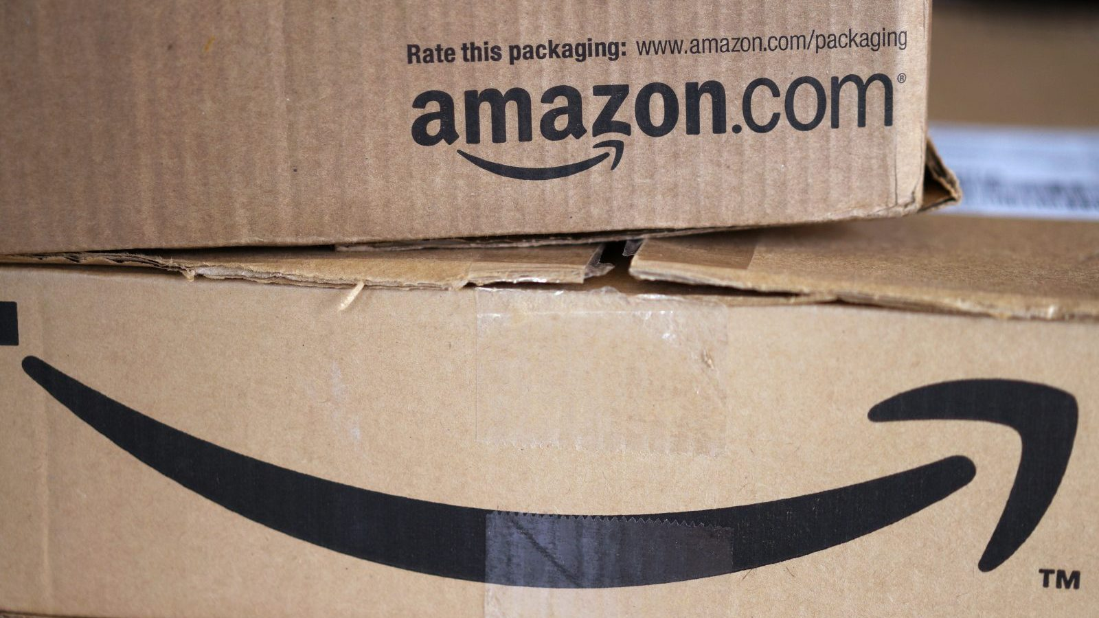 Two freshly delivered Amazon boxes are seen on a counter in Golden, Colorado August 27, 2014. With people increasingly accessing the Internet from smartphones and tablets, online companies ranging from social networks such as Facebook Inc to e-commerce companies like Amazon.com Inc have been investing heavily to develop their mobile platforms.  REUTERS/Rick Wilking (UNITED STATES - Tags: BUSINESS SCIENCE TECHNOLOGY TELECOMS) - GM1EA8S0ISL01