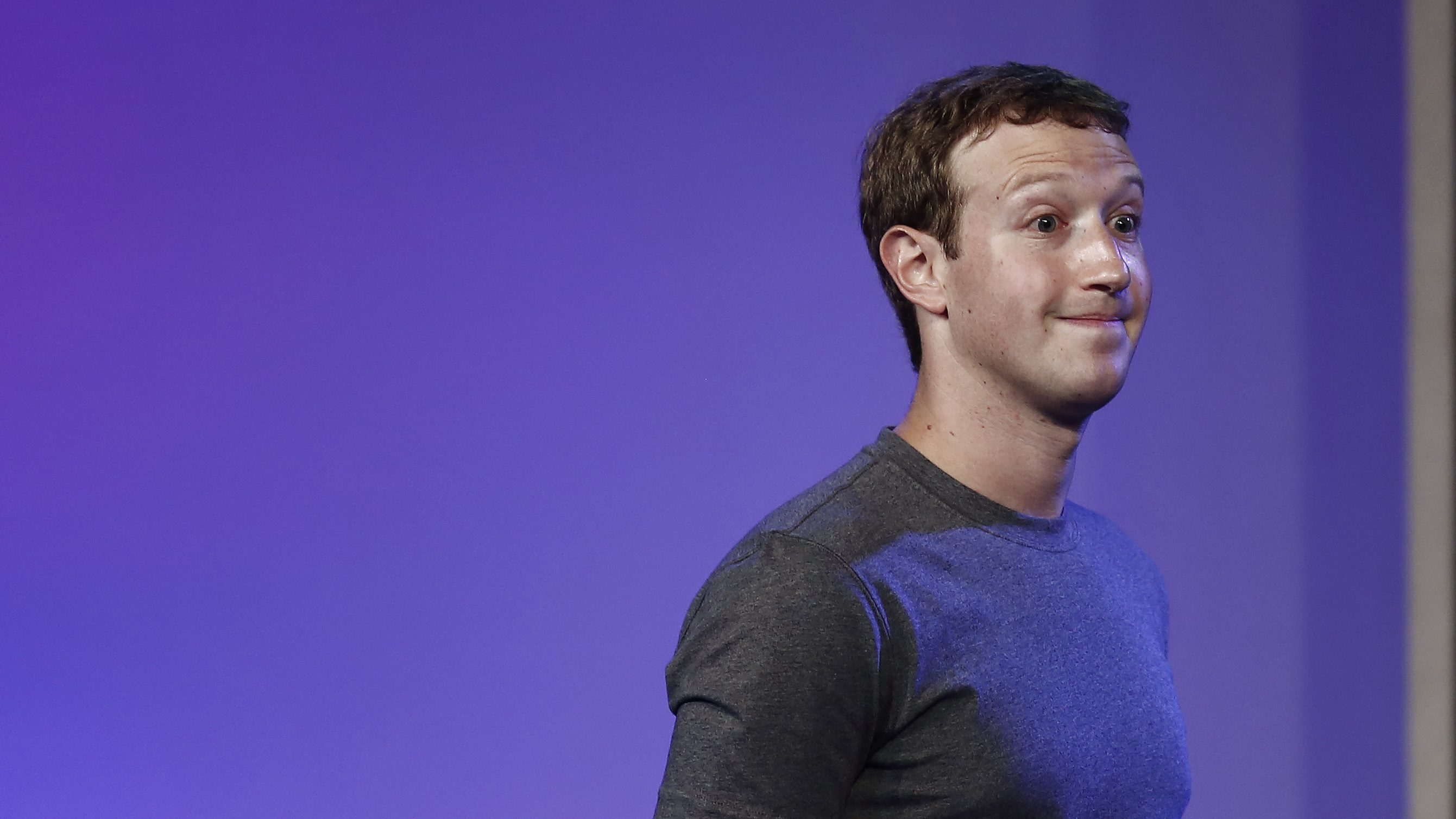 Mark Zuckerberg, founder and CEO of Facebook, reacts during an address to a gathering at the Internet.org Summit in New Delhi