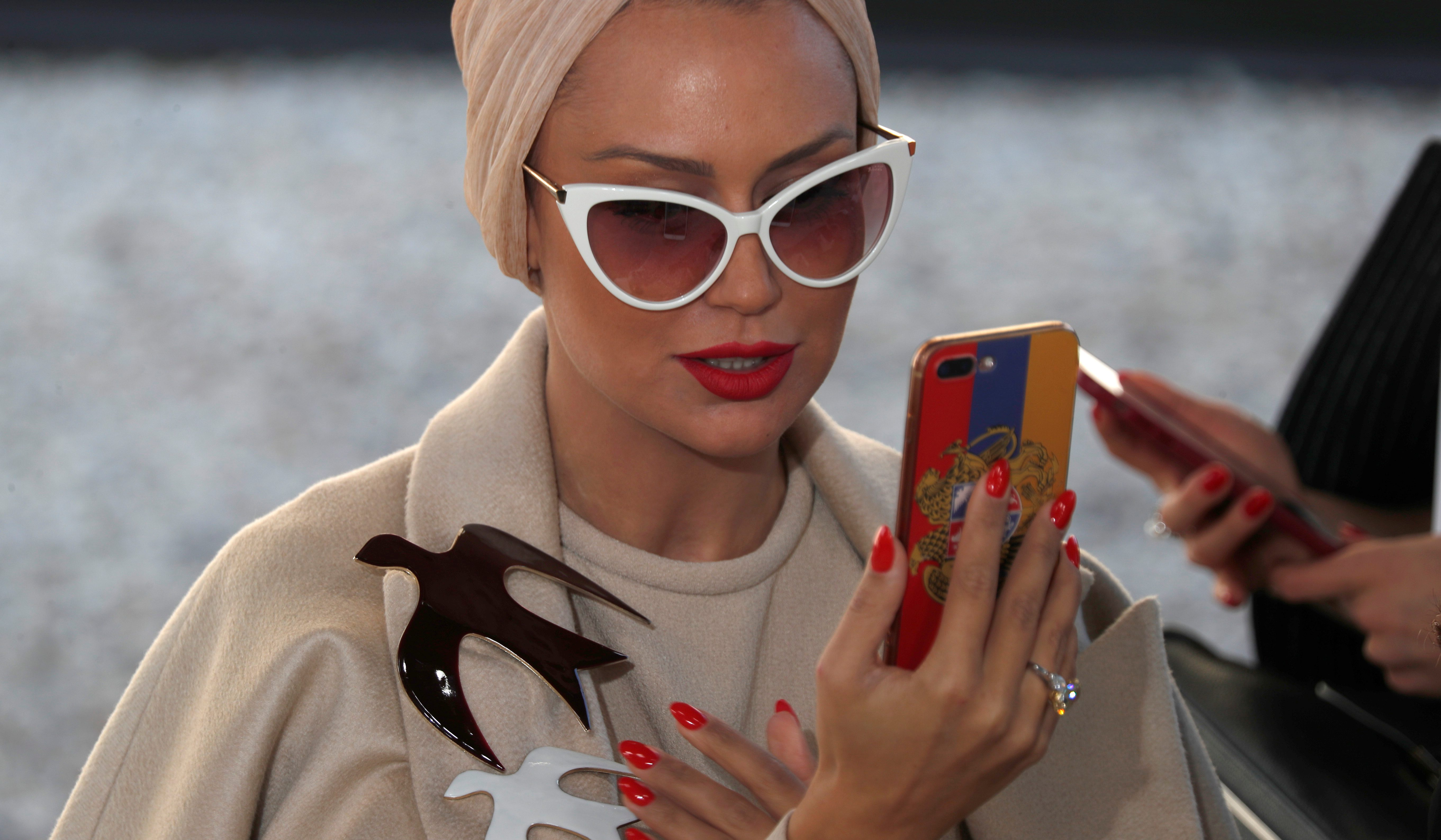 A guest on a mobile phone during Spring/Summer 2018 women's ready-to-wear collection show for fashion house Nina Ricci during Fashion Week in Paris, France, September 29, 2017. REUTERS/Charles Platiau - RC1ECFAA27F0