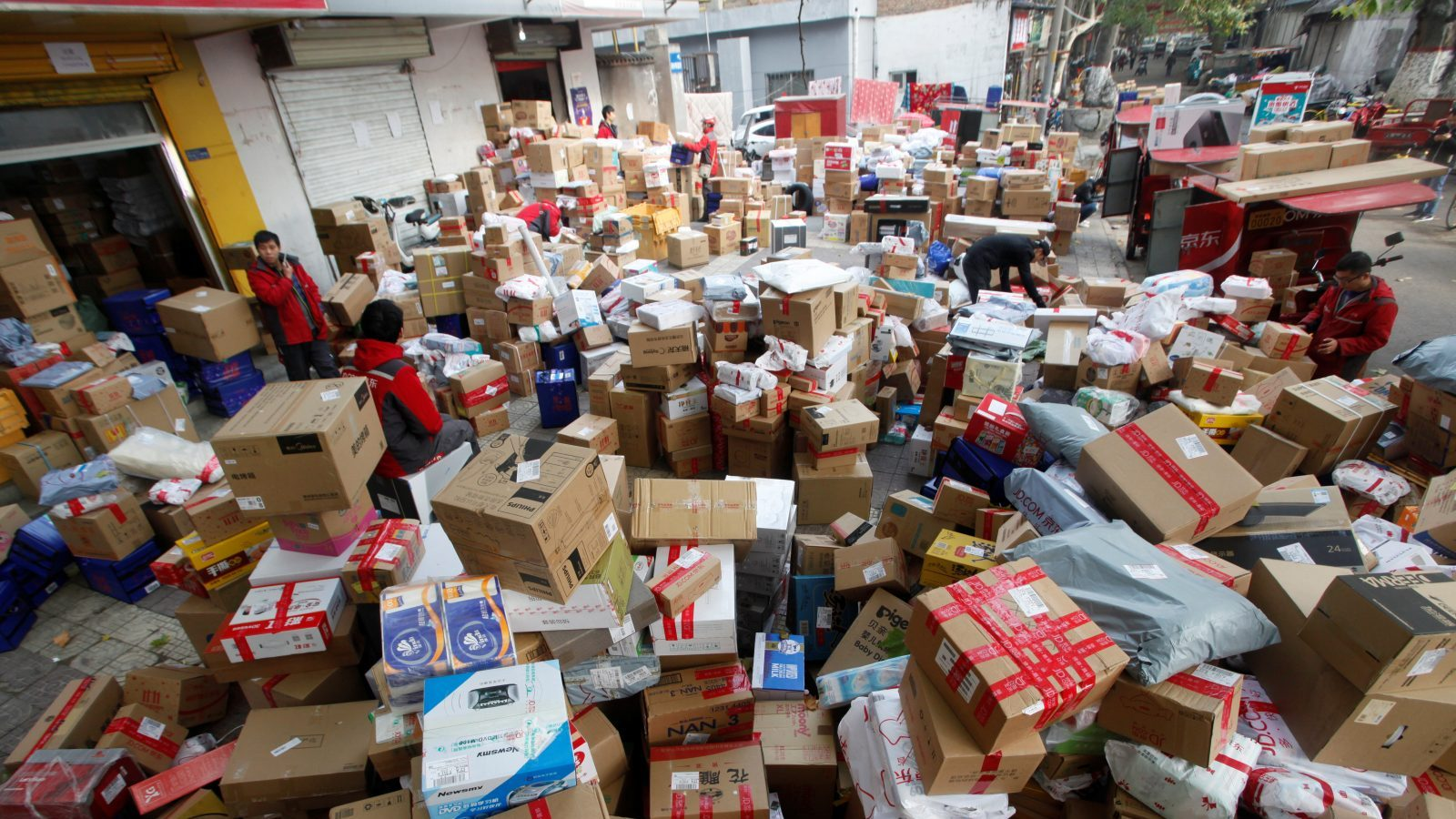 Employees sort boxes and parcels at a JD.com logistic station, after the Singles Day online shopping festival, in Xi'an, Shaanxi province, China November 13, 2017. Picture taken November 13, 2017. REUTERS/Stringer ATTENTION EDITORS - THIS IMAGE WAS PROVIDED BY A THIRD PARTY. CHINA OUT. - RC1355F86170