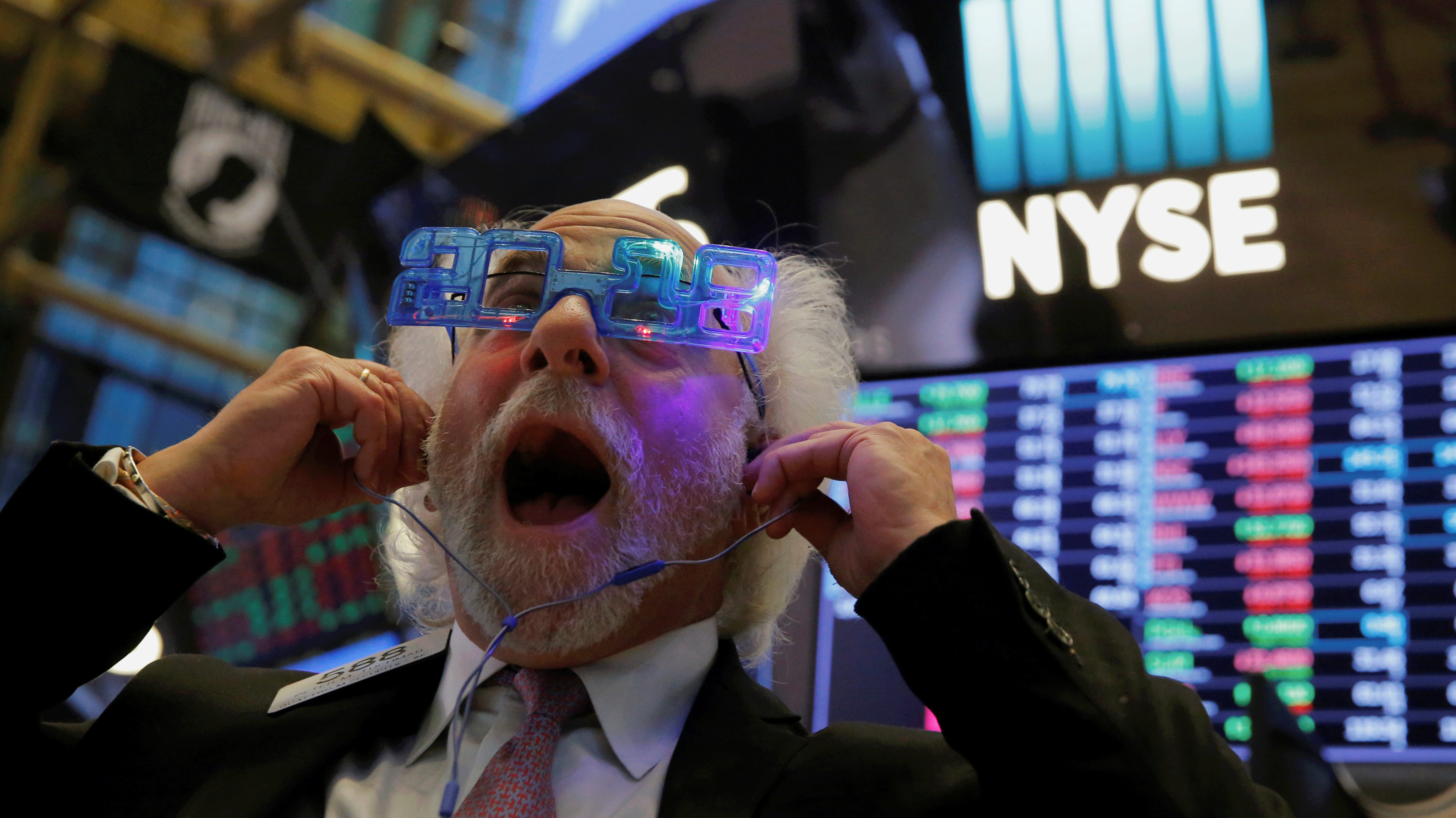 Trader Peter Tuchman reacts as the final day of trading for the year draws to a close at the New York Stock Exchange (NYSE) in Manhattan, New York