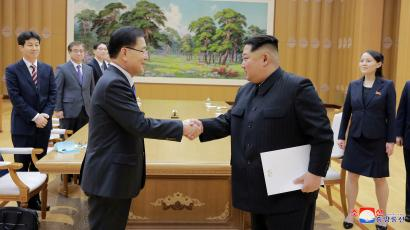 North Korean leader Kim Jong Un shakes hands with Chung Eui-yong who is leading a special delegation of South Korea's President, in this photo released by North Korea's Korean Central News Agency (KCNA) on March 6, 2018
