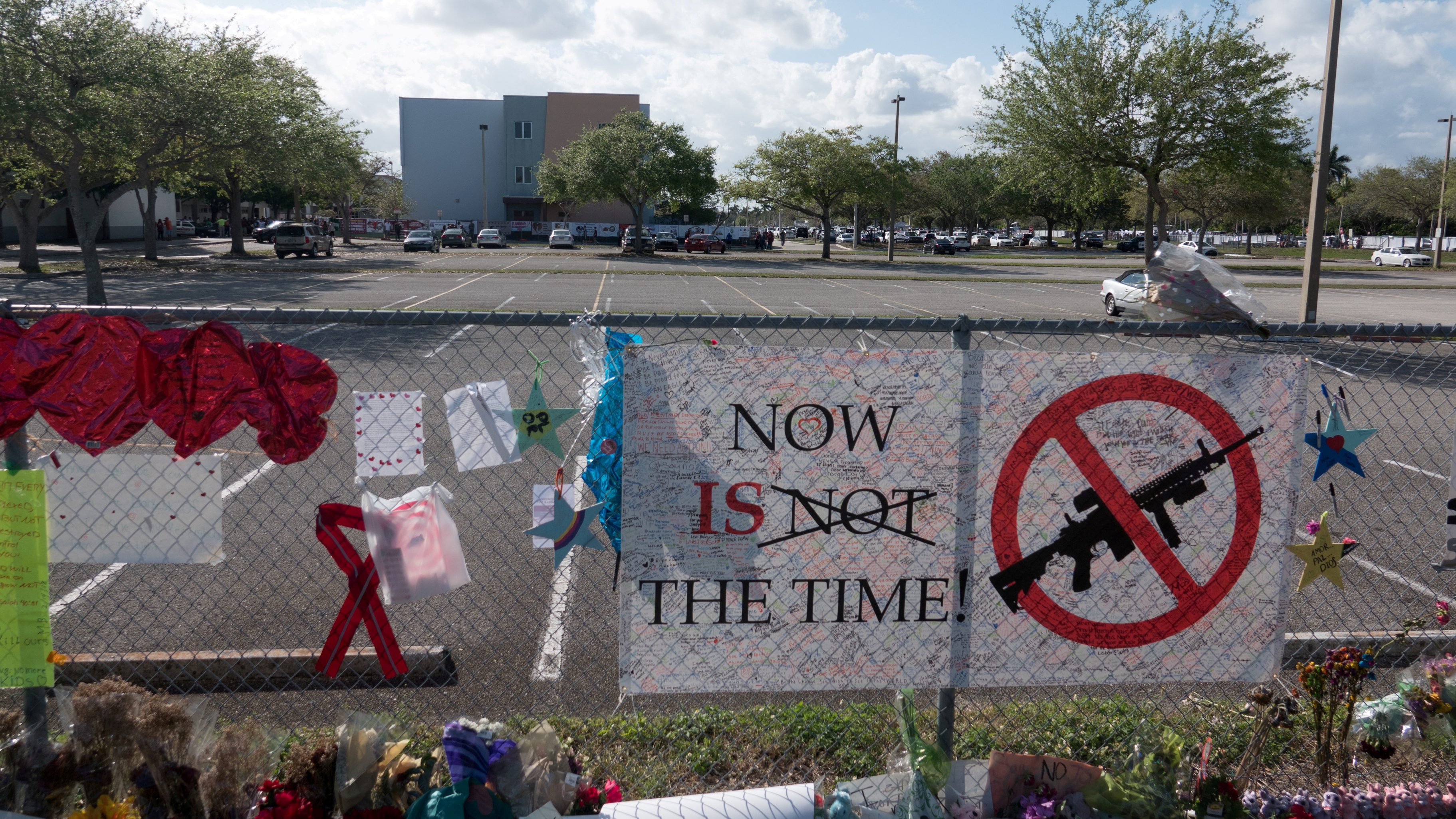 FILE PHOTO: Messages, posted on a fence, hang, as students and parents attend a voluntary campus orientation at the Marjory Stoneman Douglas High School, for the coming Wednesday's reopening, following last week's mass shooting in Parkland, Florida, U.S., February 25, 2018. REUTERS/Angel Valentin/File photo NO RESALES. NO ARCHIVES - RC11BE5B3210