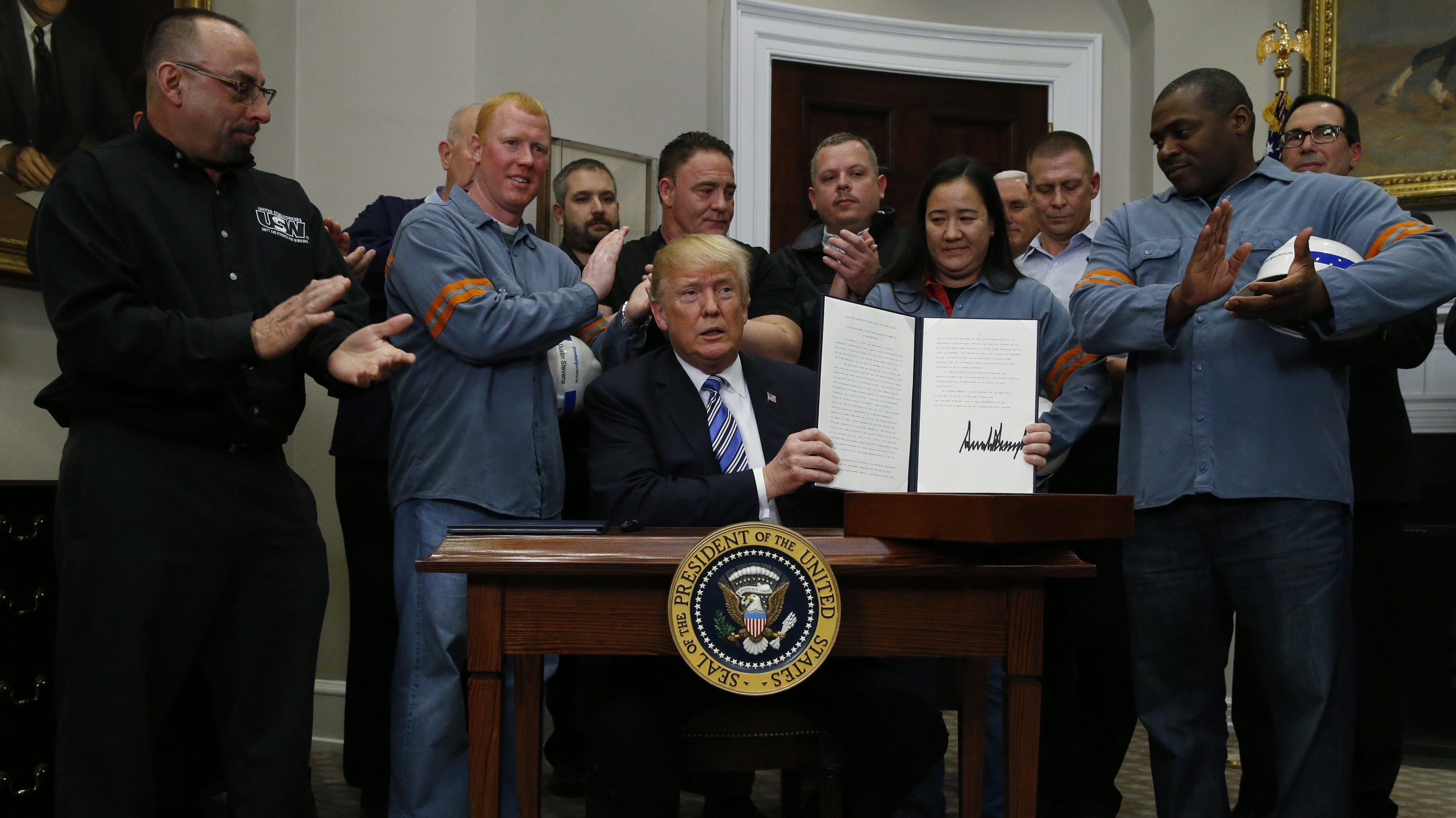 U.S. President Donald Trump is after signing a proclamation to establish tariffs on imports of steel and aluminum at the White House in Washington, U.S., March 8, 2018. REUTERS/Leah Millis - HP1EE381MUXAU