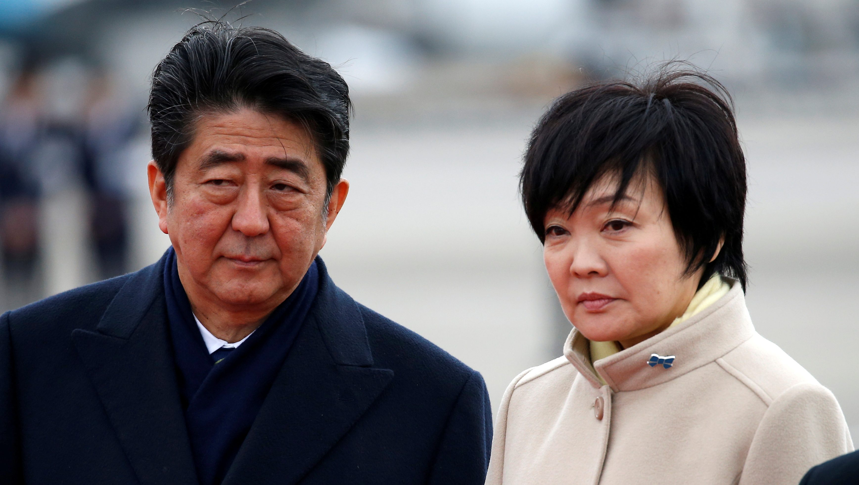 Japan's Prime Minister Shinzo Abe (L) and his wife Akie at Haneda Airport in Tokyo, Japan February 28, 2017.