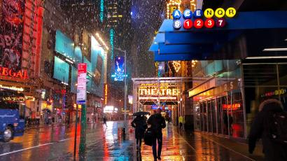 People walk to work in Midtown Manhattan during the third winter storm in two weeks early morning in New York City