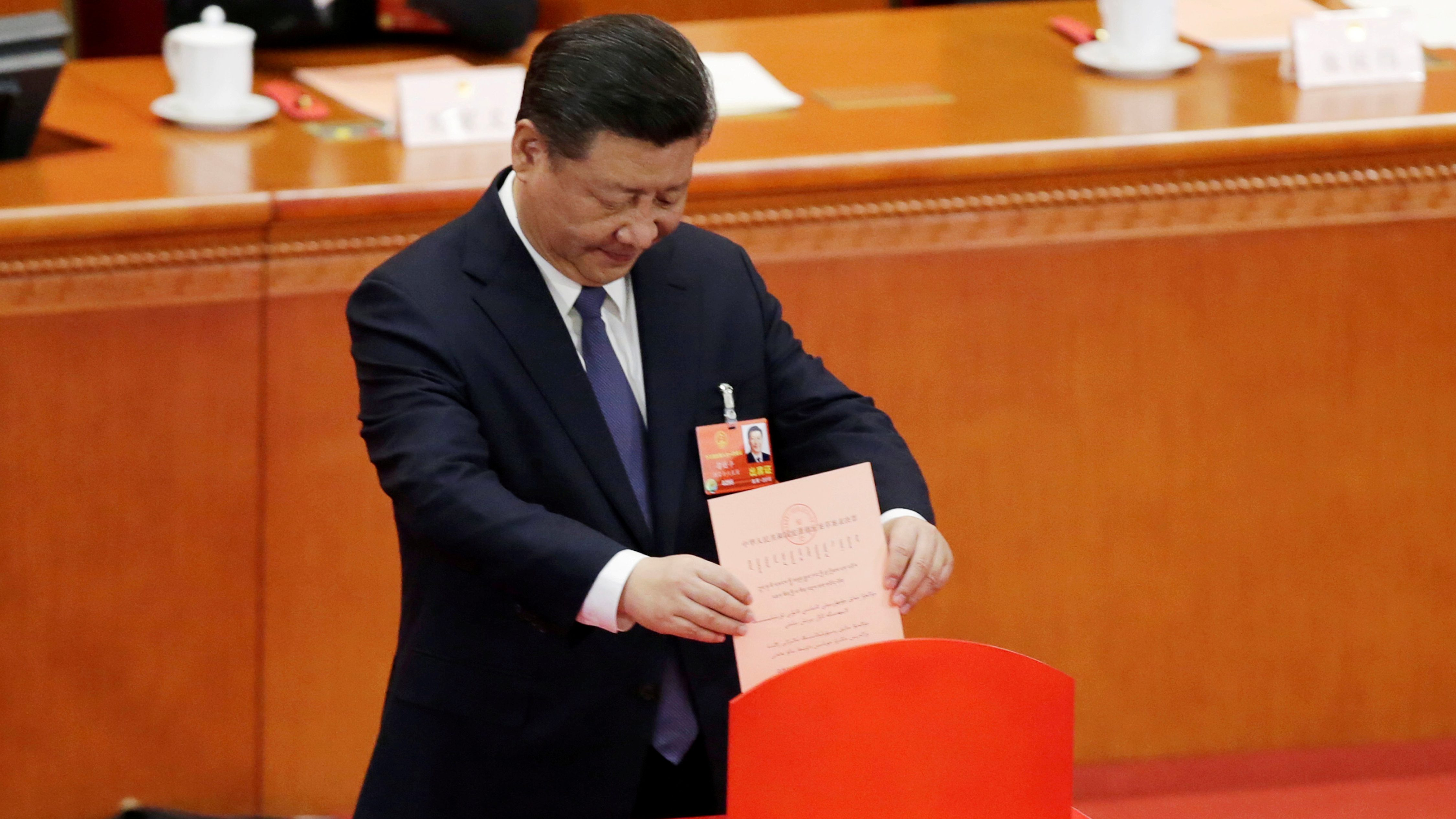 Chinese President Xi Jinping drops his ballot during a vote on a constitutional amendment lifting presidential term limits, at the third plenary session of the National People's Congress (NPC) at the Great Hall of the People in Beijing, China March 11, 2018. To match Analysis CHINA-PARLIAMENT/DISSENT
