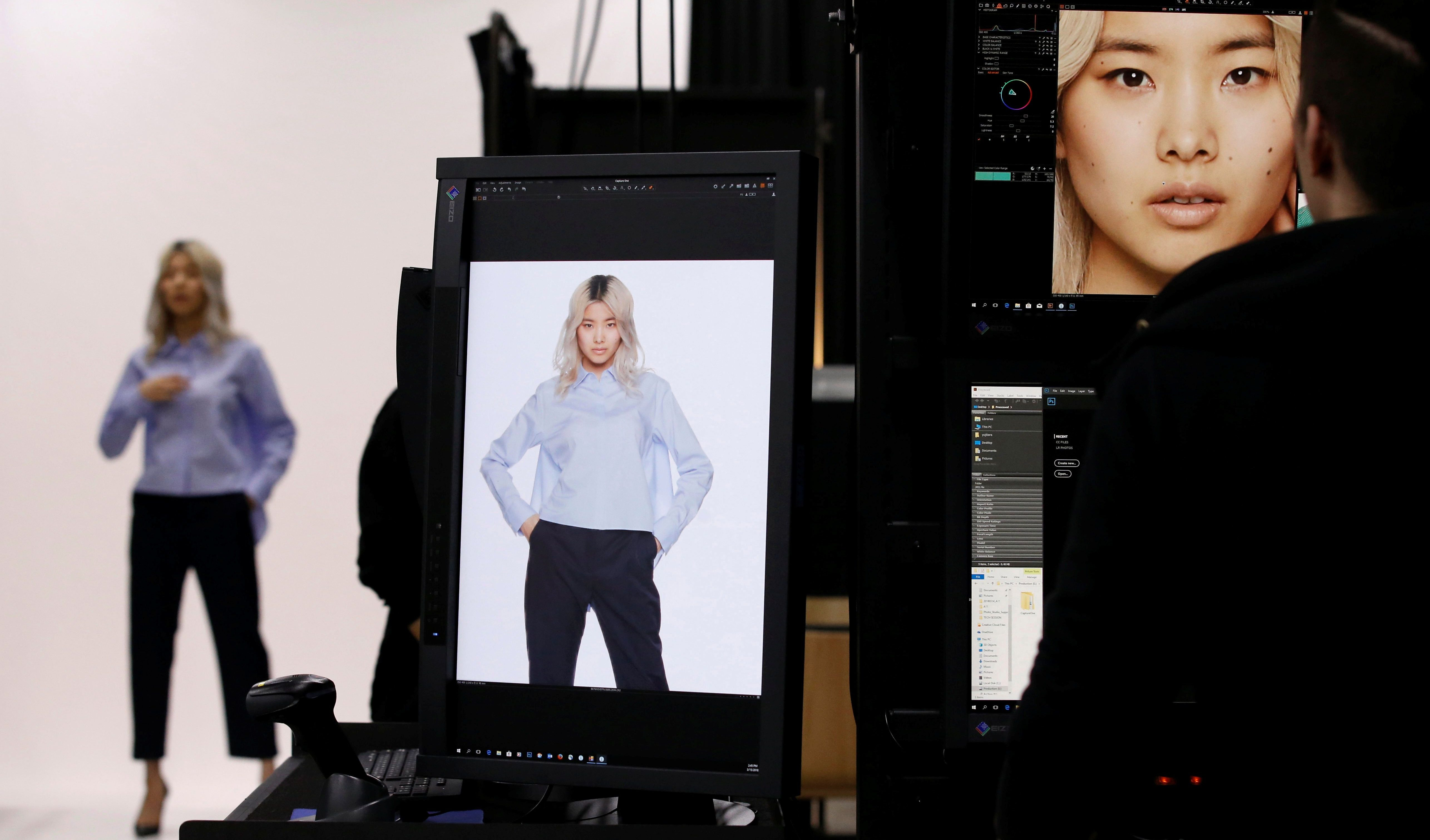 A model is seen during a shooting session for Amazon Fashion at an unveiling of its new photo studio in Tokyo, Japan March 15, 2018.  REUTERS/Toru Hanai - RC11C1FABC40