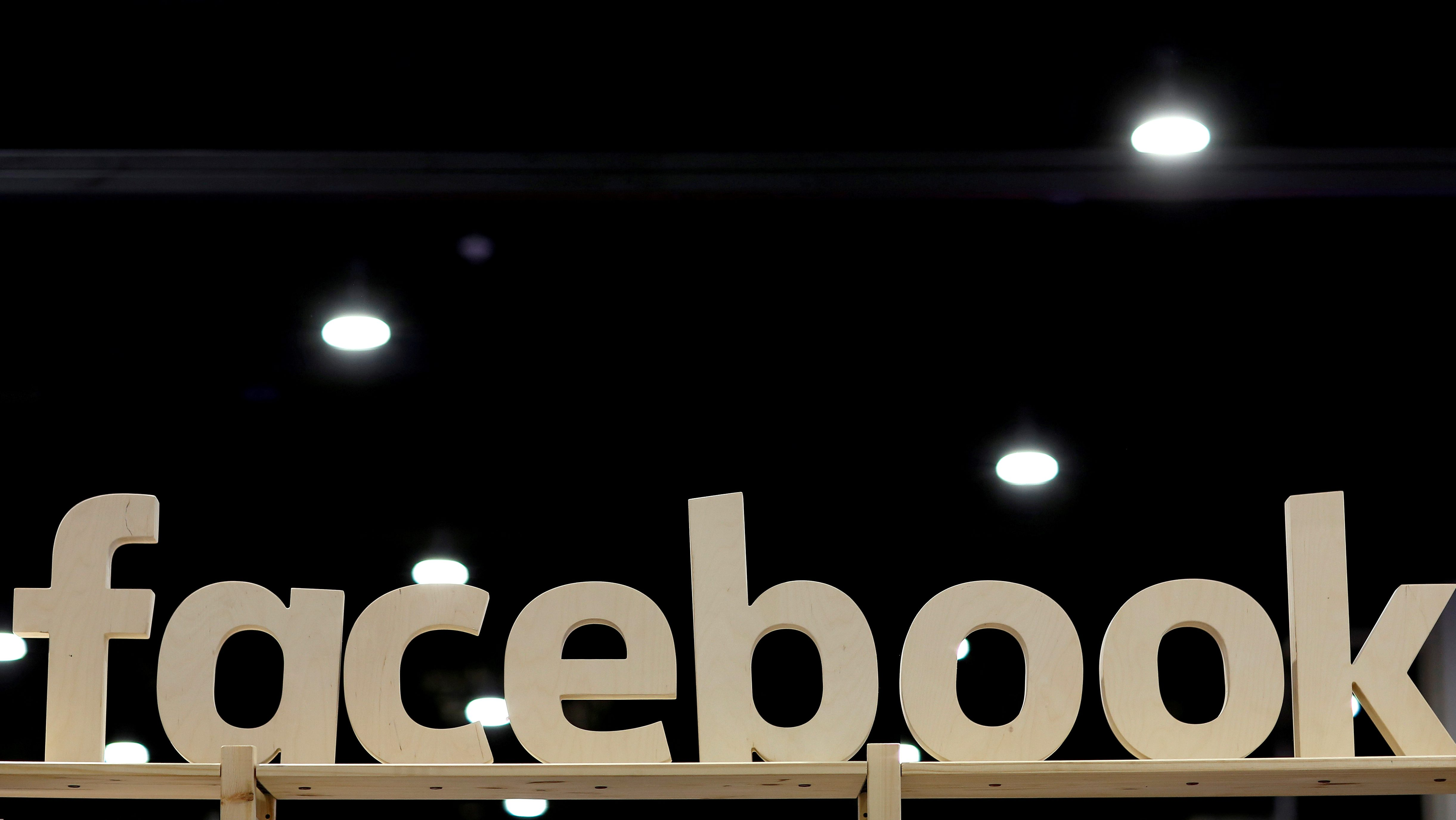 FILE PHOTO: A Facebook sign is displayed at the Conservative Political Action Conference (CPAC) at National Harbor, Maryland, U.S., February 23, 2018. REUTERS/Joshua Roberts/File Photo - RC1A218B6860