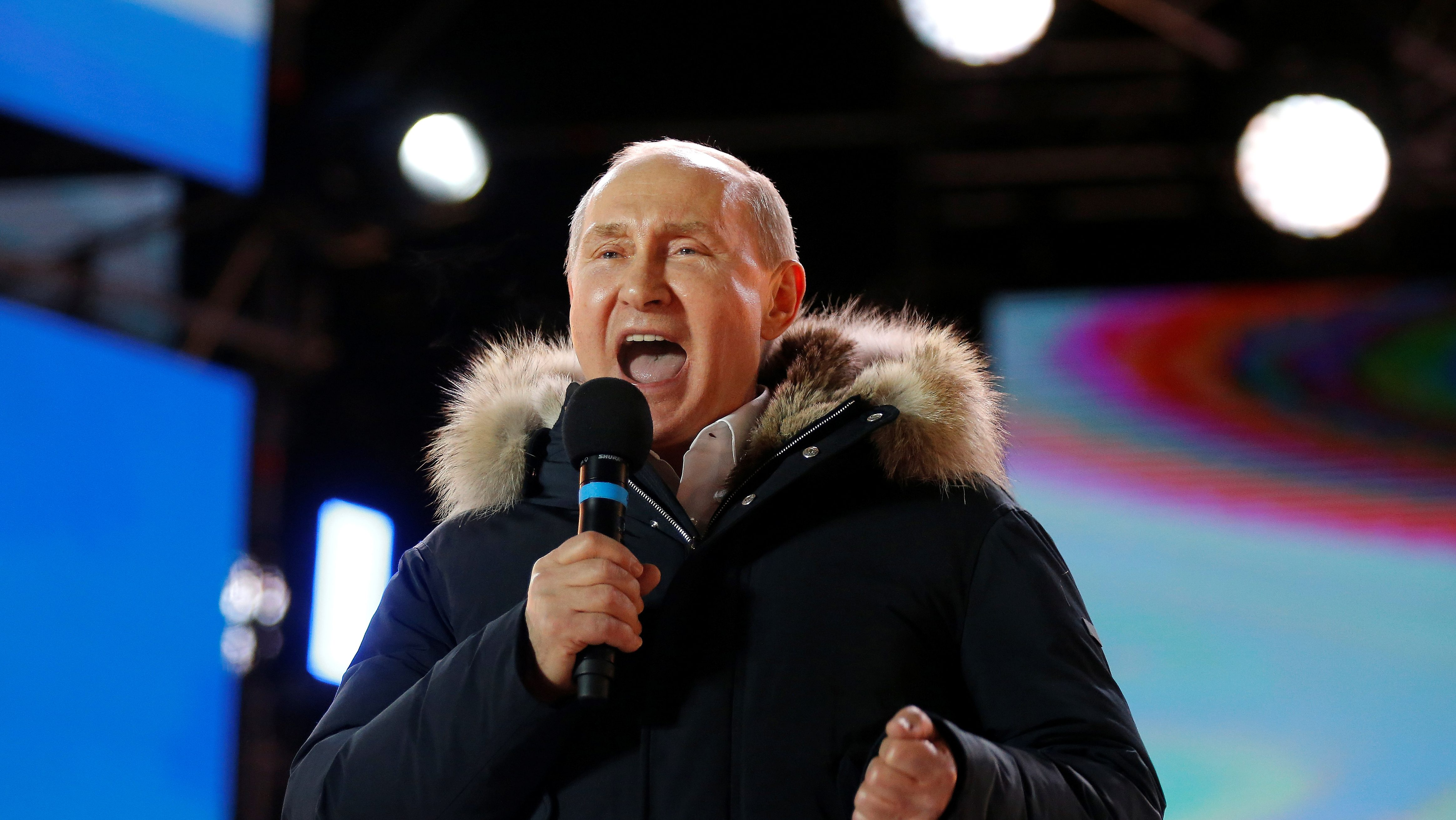 Russian President and Presidential candidate Vladimir Putin delivers a speech during a rally and concert marking the fourth anniversary of Russia's annexation of the Crimea region, at Manezhnaya Square in central Moscow, Russia March 18, 2018. Alexander Zemlianichenko/POOL via Reuters - RC1C06D990E0