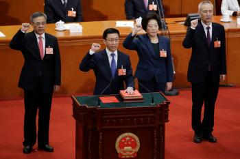 Newly elected Vice Premiers (L-R) Hu Chunhua, Han Zheng, Sun Chunlan and Liu He take an oath to the constitution at the seventh plenary session of the National People's Congress (NPC) at the Great Hall of the People in Beijing, China March 19, 2018.