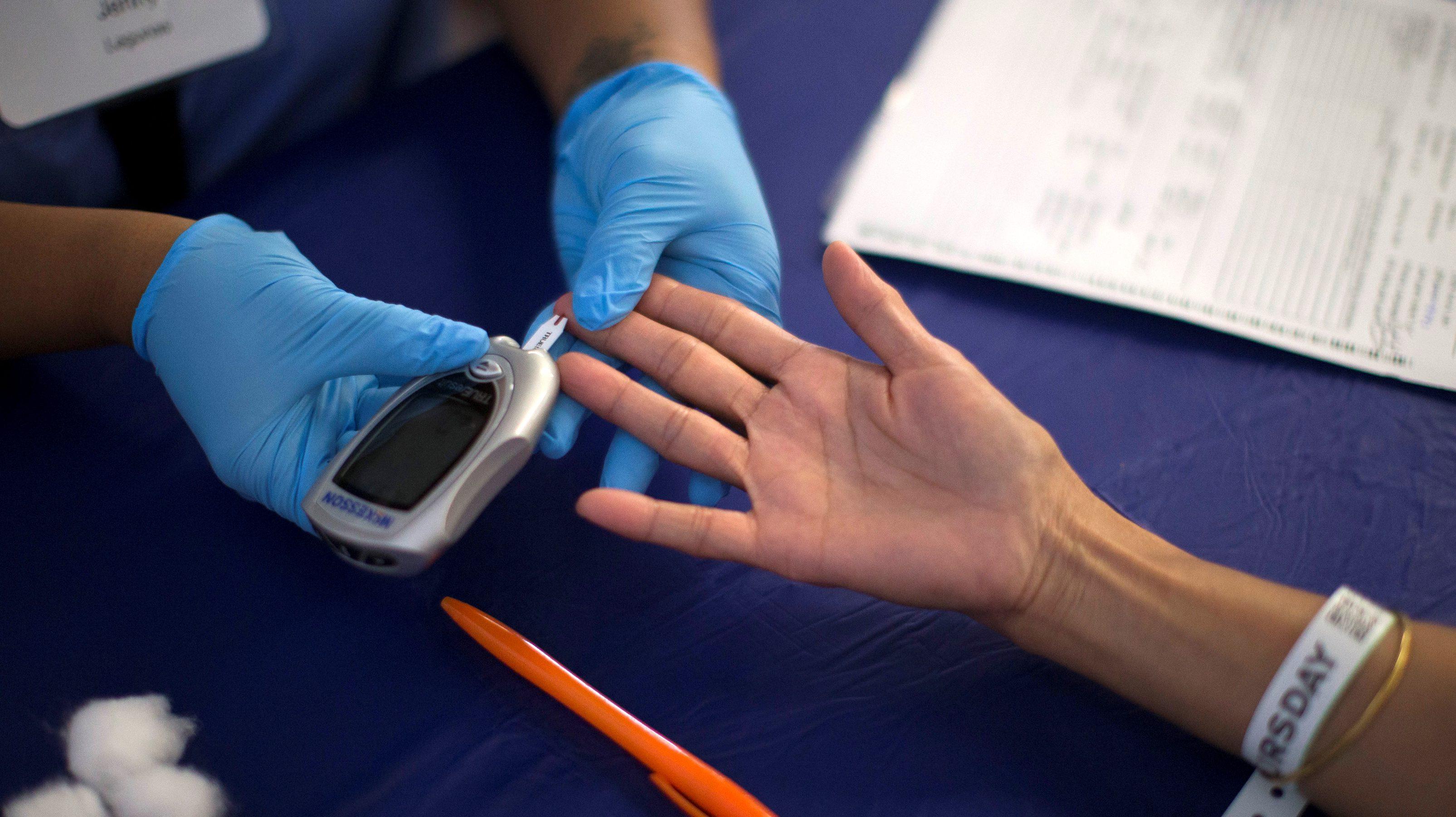 A person receives a test for diabete