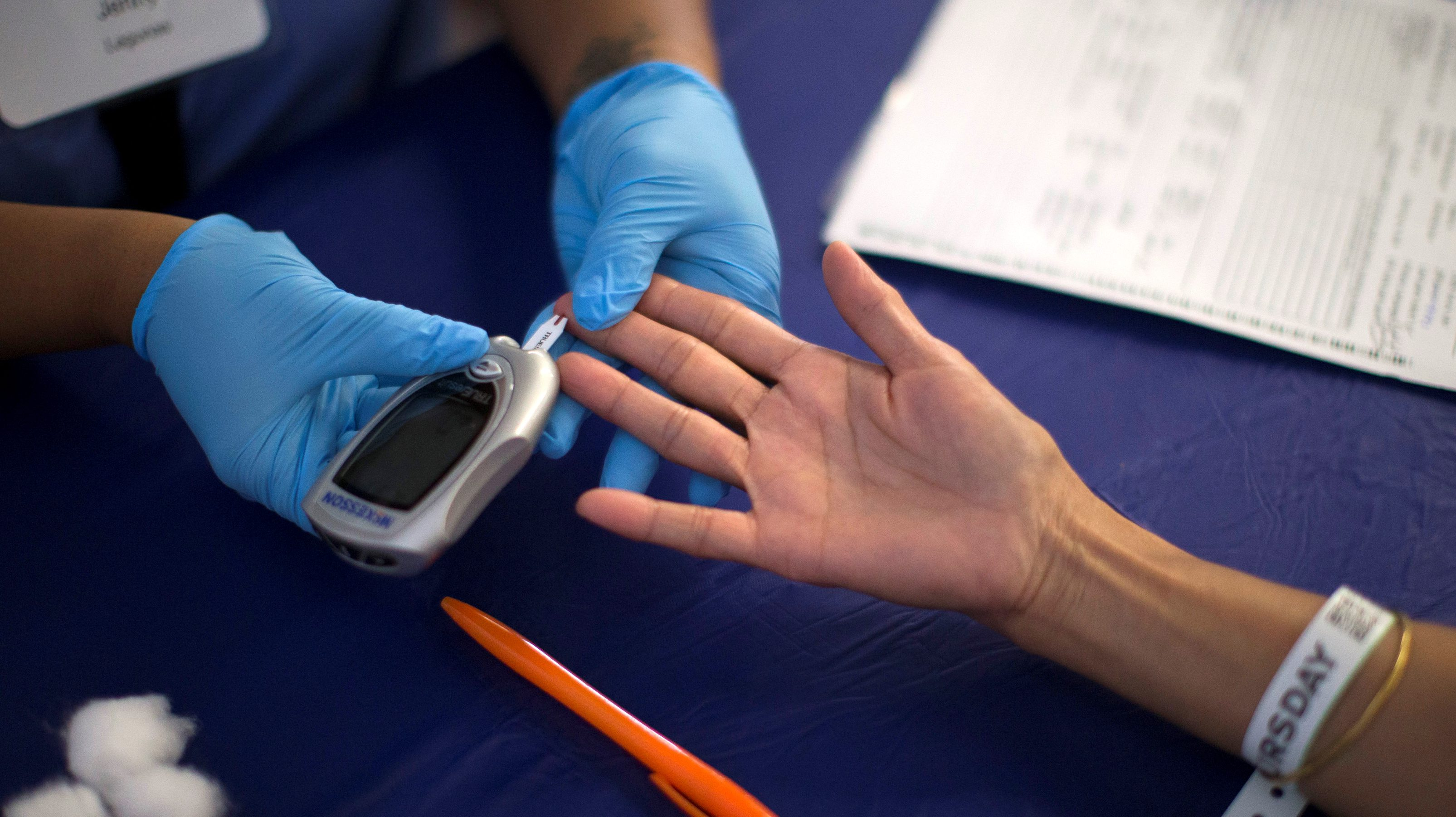A person receives a test for diabete