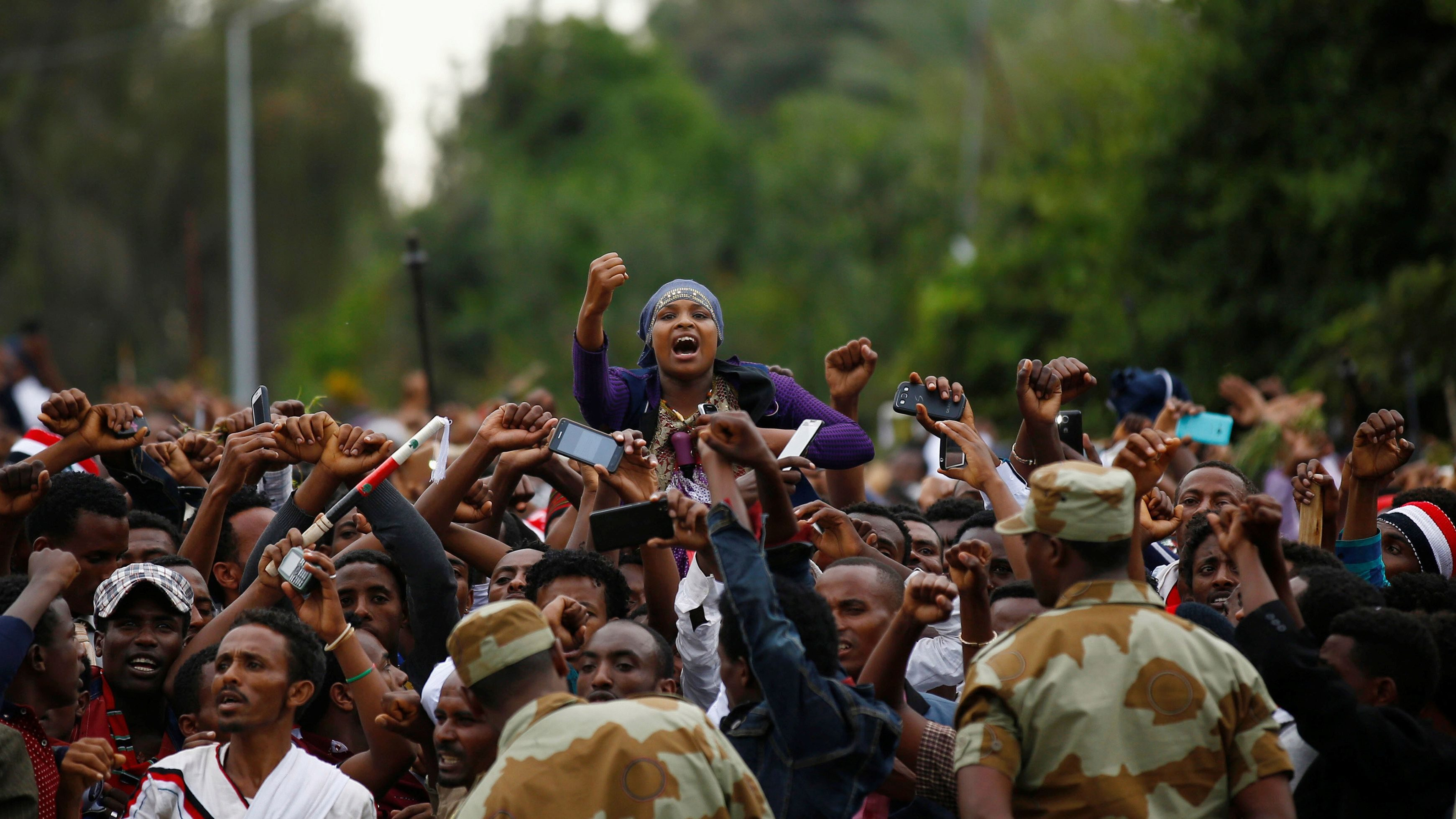 Demonstrators chant slogans while flashing the Oromo protest gesture during Irreecha, the thanksgiving festival of the Oromo people, in Bishoftu town, Oromia region, Ethiopia, October 2, 2016.