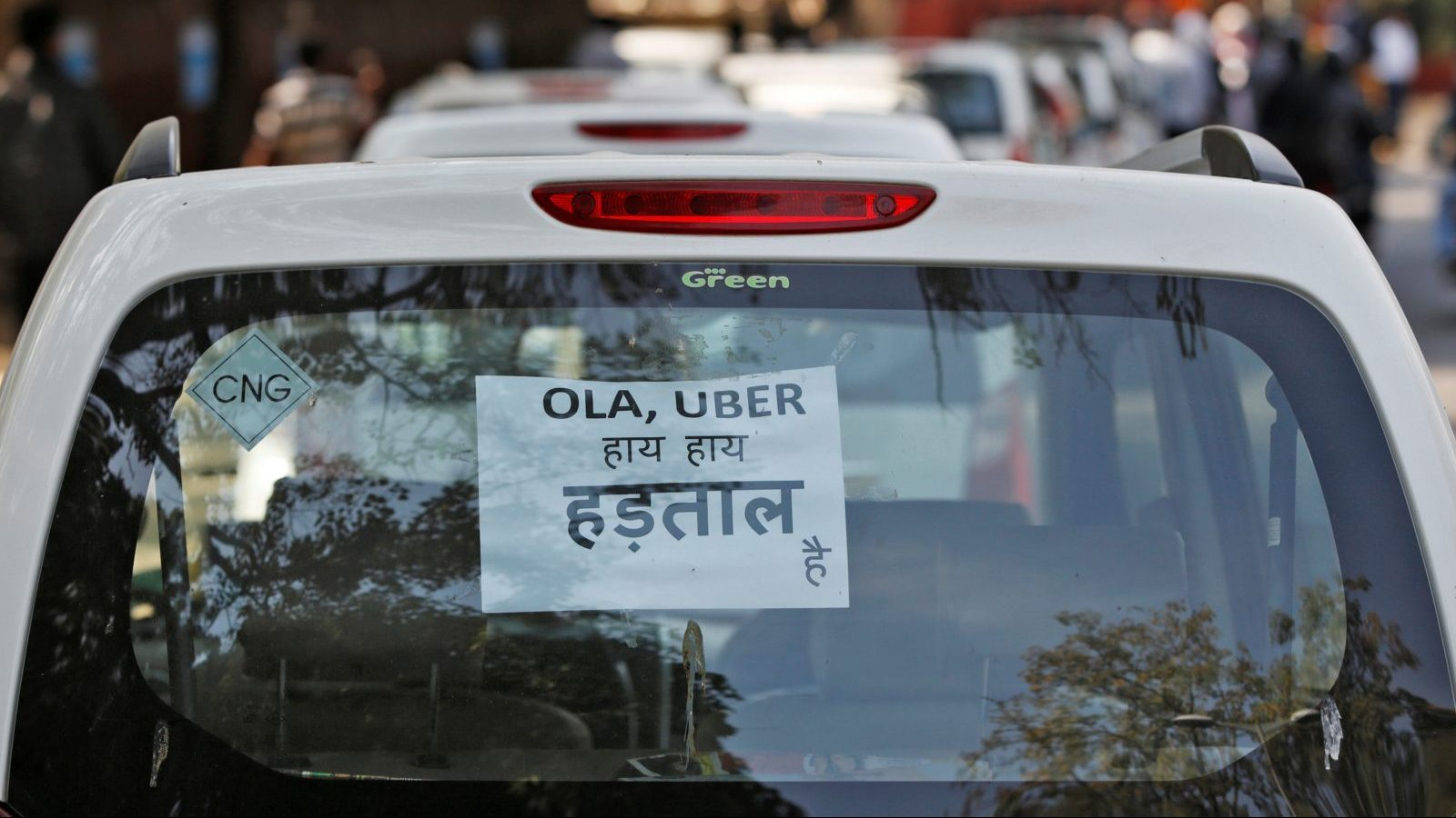 """A note is pasted on a rear window of a car during a protest by Uber and Ola drivers, in New Delhi, India, February 14, 2017. The note reads """"Ola and Uber it is Strike"""". REUTERS/Adnan Abidi - RC18A770D170"""