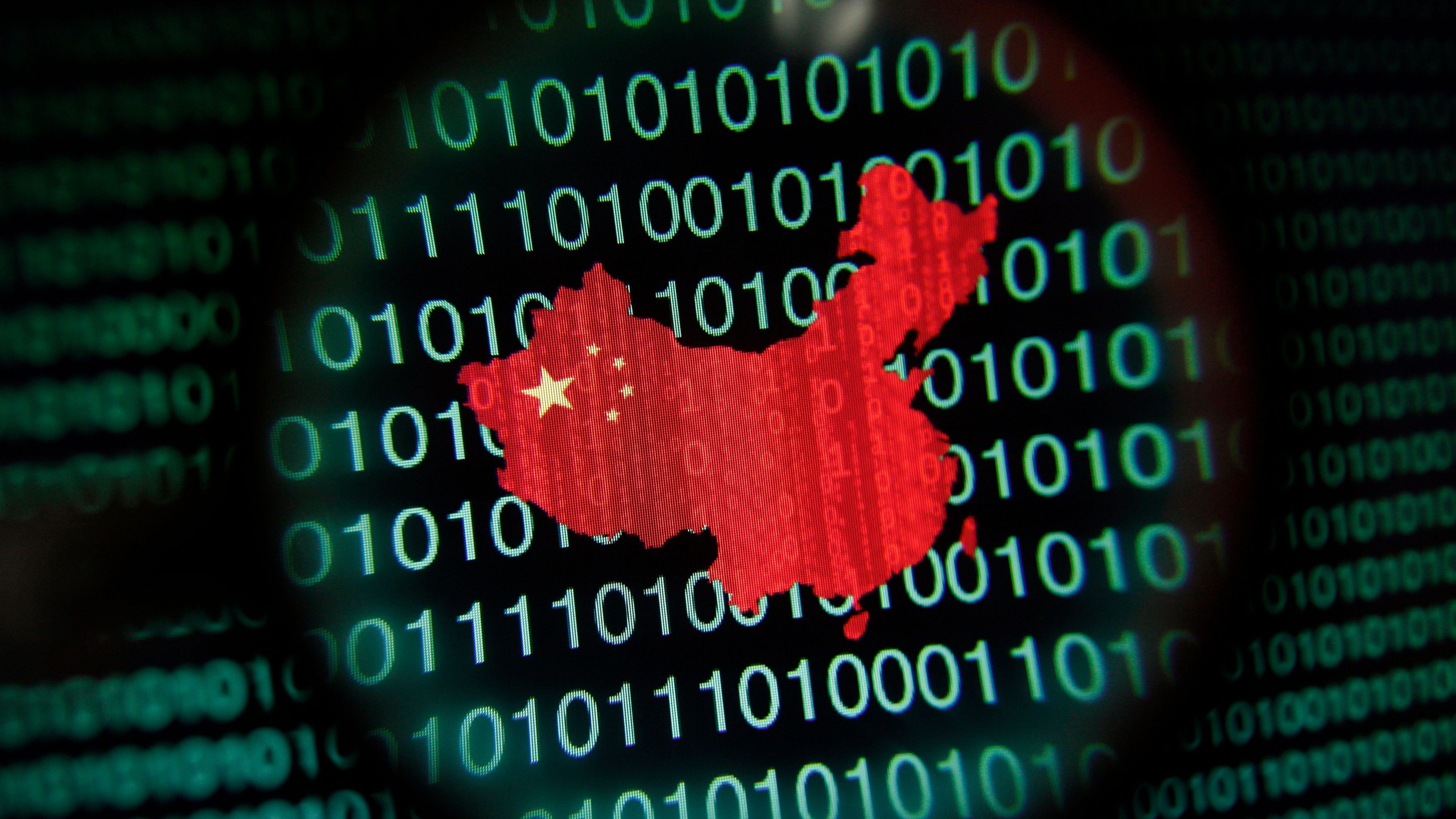 A map of China is seen through a magnifying glass on a computer screen showing binary digits in Singapore in this January 2, 2014 photo illustration.