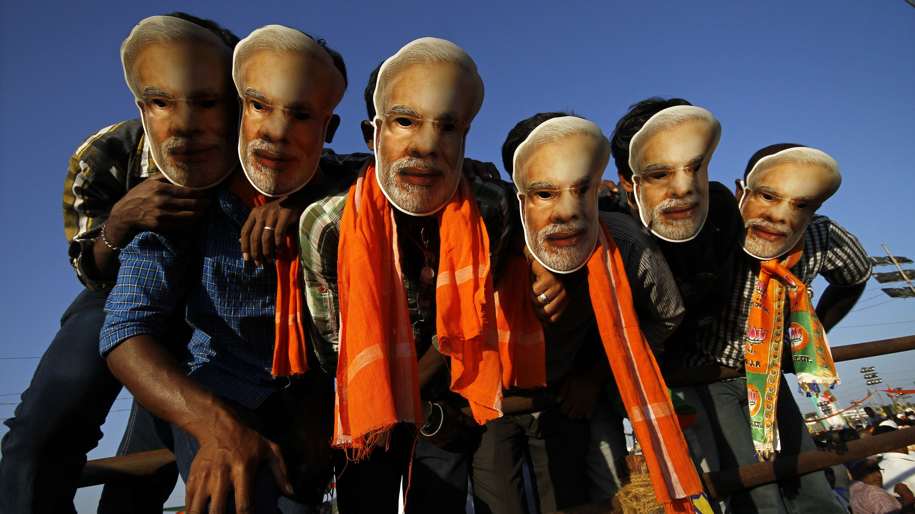 Supporters of Gujarat's chief minister and Hindu nationalist Narendra Modi, the prime ministerial candidate for India's main opposition Bharatiya Janata Party (BJP), wear masks of Modi during a rally being addressed by Modi ahead of the 2014 general elections, in the southern Indian city of Chennai February 8, 2014. REUTERS/Babu (INDIA - Tags: POLITICS) - GM1EA29050Y01