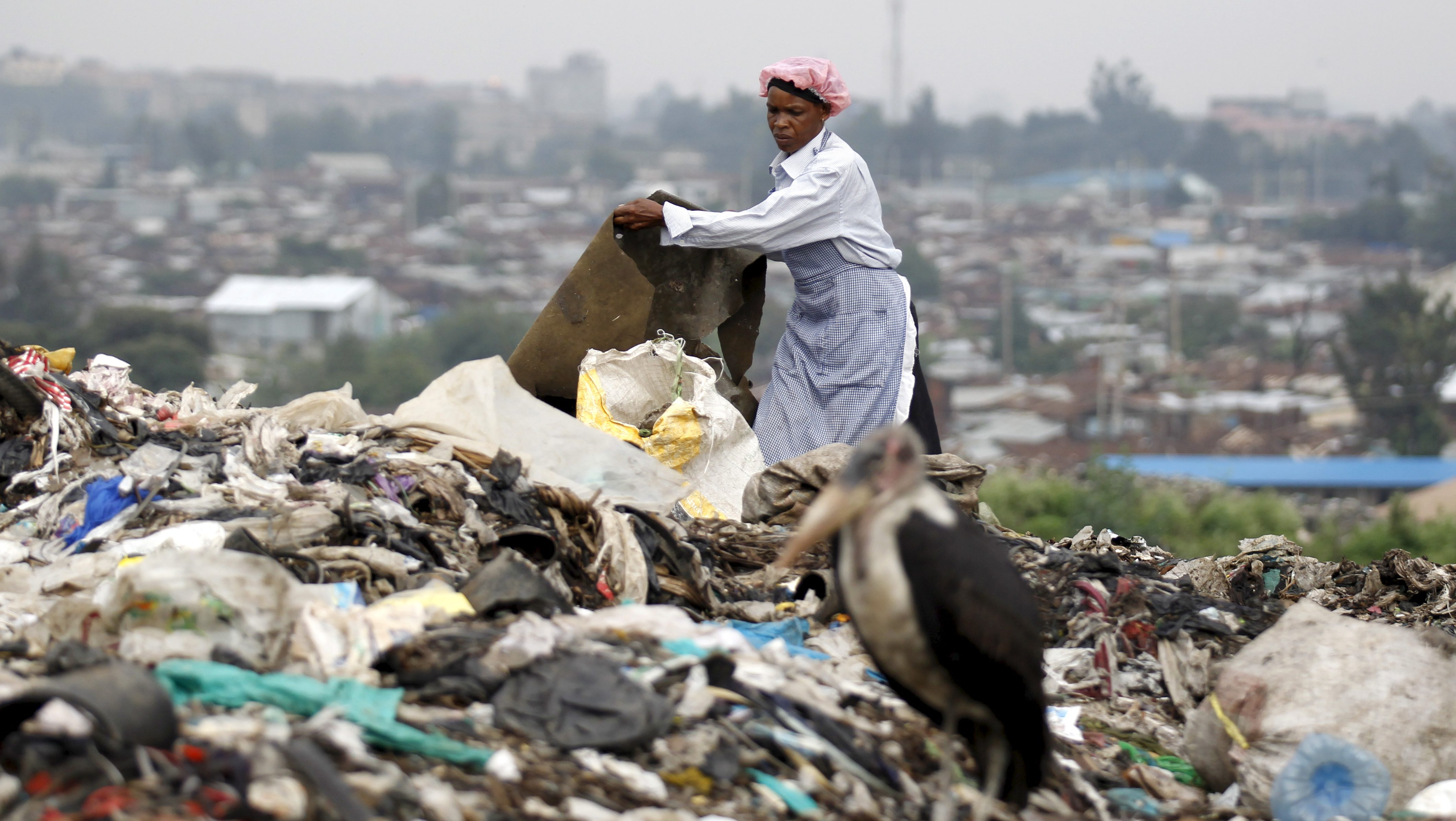 A woman scavenges for recyclable materials at the Dandora dumping site on the outskirts of Kenya's capital Nairobi
