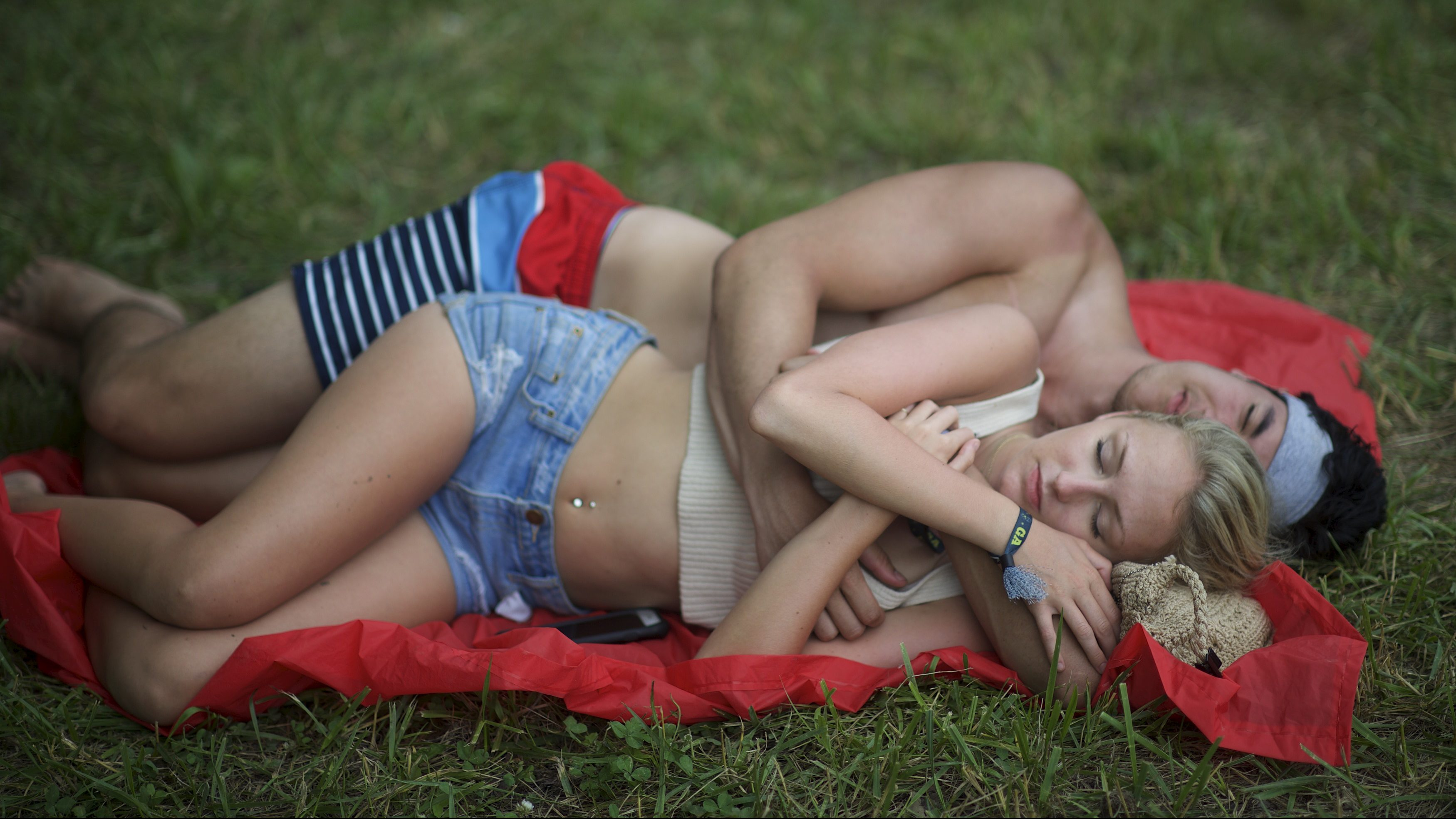 A couple embraces during the Firefly Music Festival in Dover
