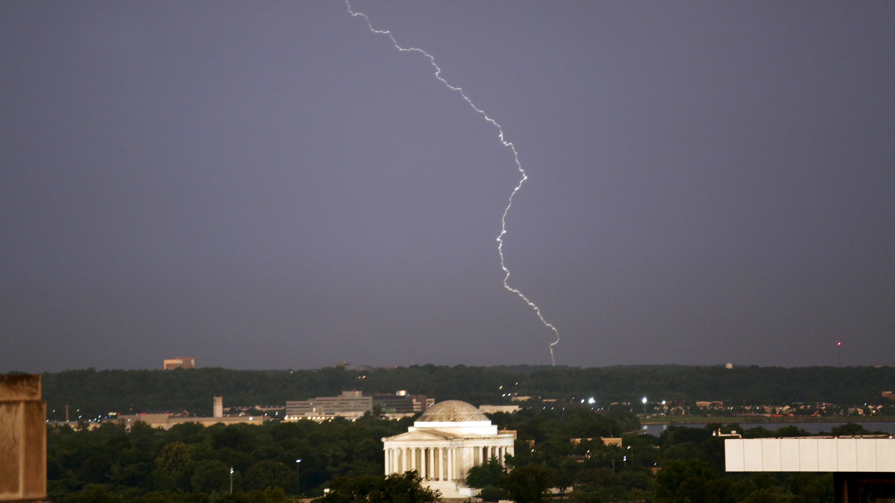 A lightening strikes the sky above the Jefferson Memorial after a severe storm in Washington June 23, 2015. REUTERS/Yuri Gripas - GF10000137324