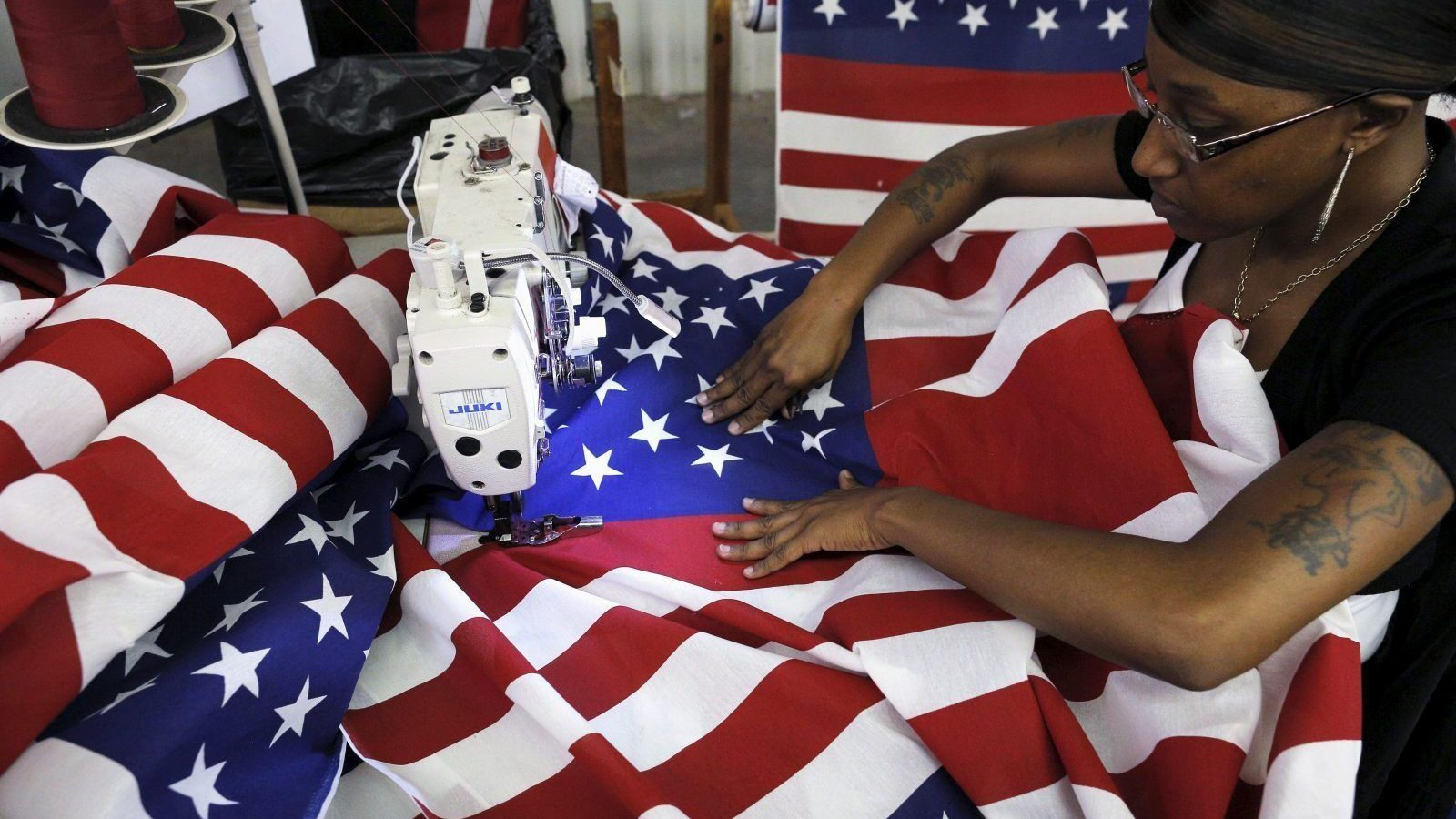 Keisha Hardman cuts and sews U.S. flags at Valley Forge's manufacturing facility in Lane, South Carolina June 23, 2015. Prominent U.S. flag makers said on Tuesday they will stop manufacturing and selling Confederate battle flags after last week's attack on worshippers at a black church in Charleston, South Carolina. Reggie VandenBosch, vice president of sales at privately owned Valley Forge Flag, said the Pennsylvania-based company came to the decision as pressure grew on South Carolina to remove the banner from outside the State House in Columbia. The 133-year-old company sells millions of flags each year, VandenBosch said, with Confederate flags making up only a tiny slice of that business. REUTERS/Brian Snyder - GF10000137311