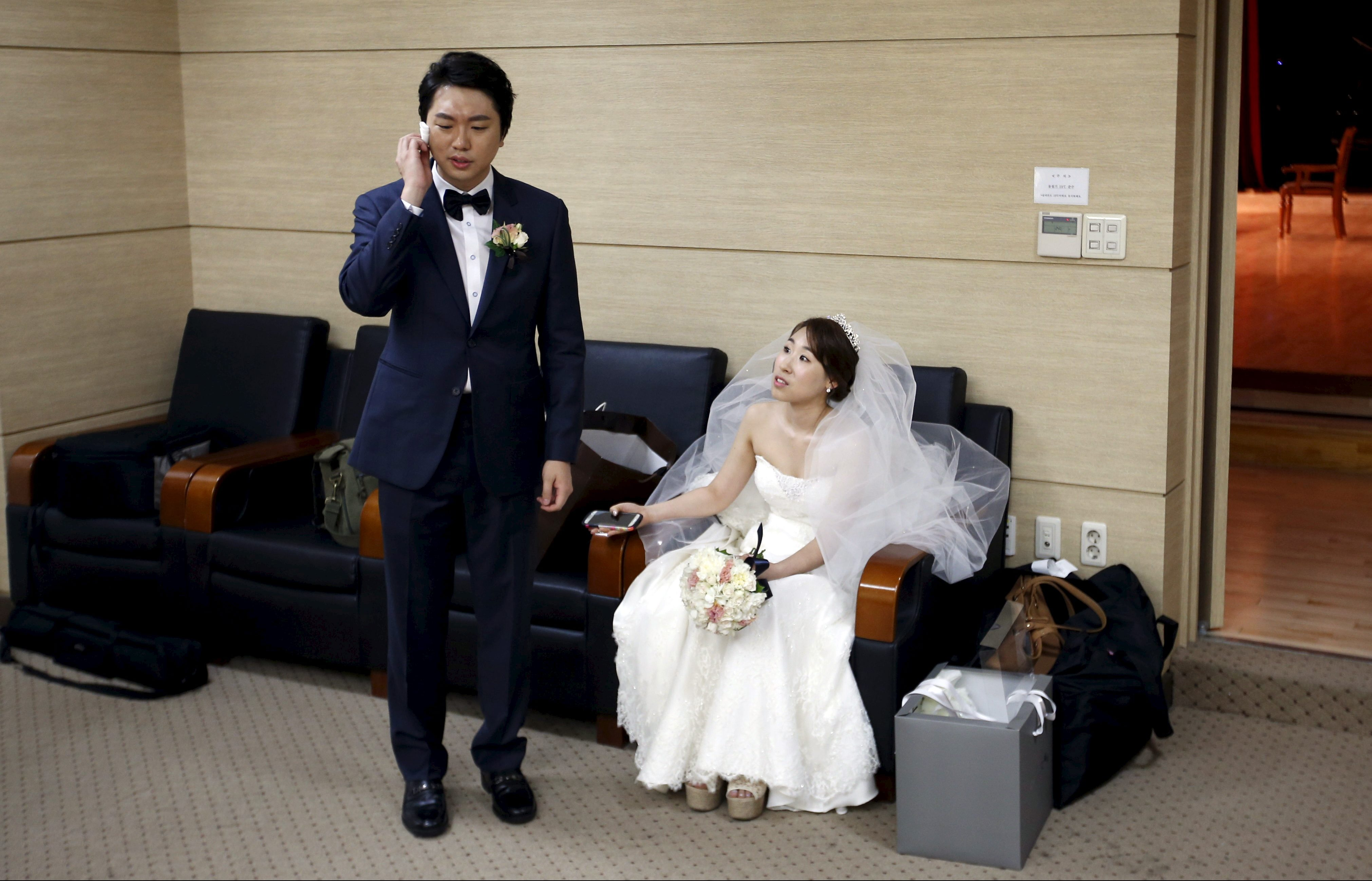 Bridal couple gets ready for their wedding ceremony at a budget wedding hall at the National Library of Korea in Seoul, South Korea