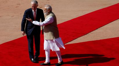 India's Prime Minister Modi gesutres as his Australian counterpar Turnbull watches during Turnbull's ceremonial reception at the forecourt of India's Rashtrapati Bhavan presidential palace in New Delhi