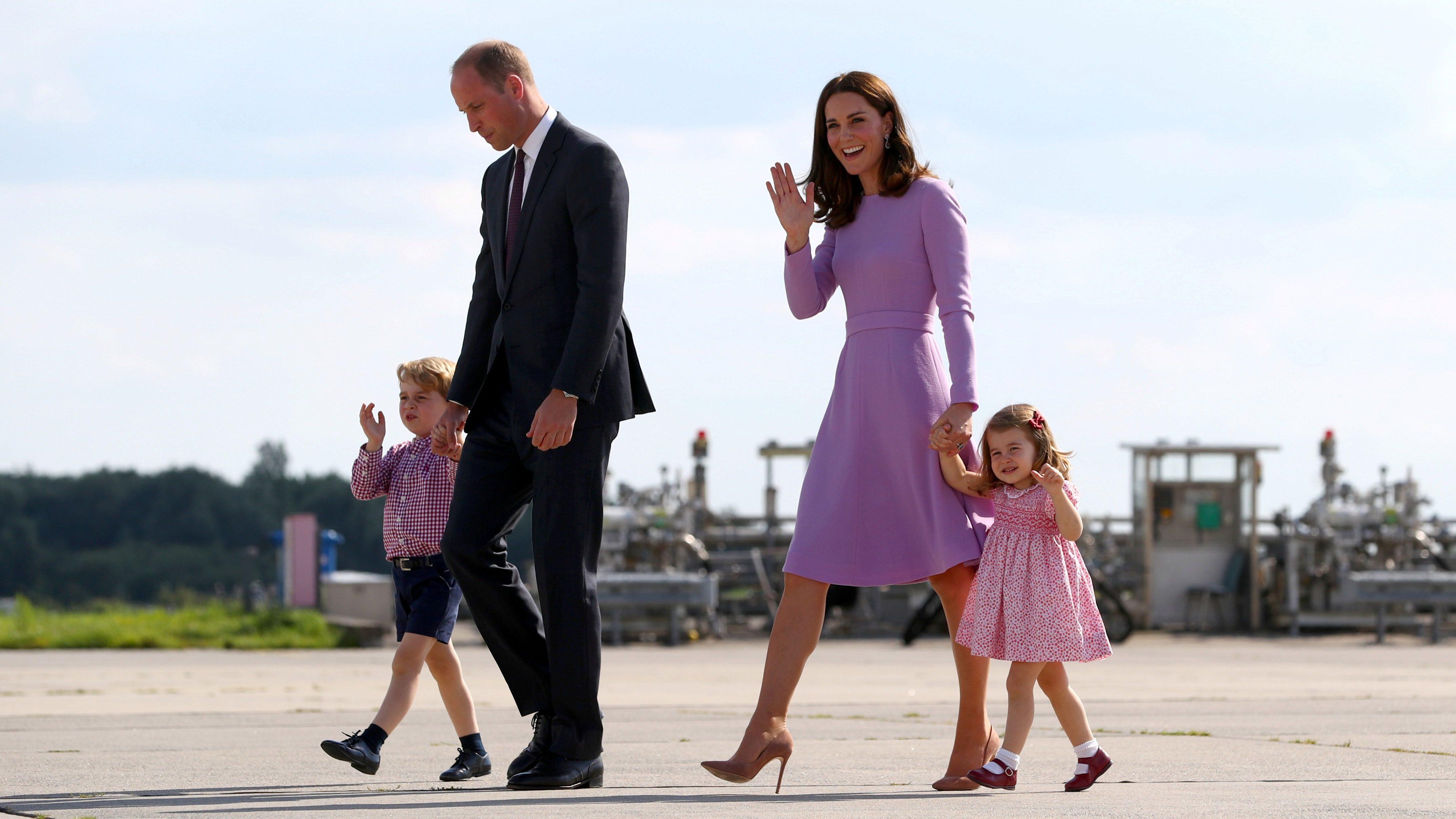 Britain's Prince William and his wife Catherine, Duchess of Cambridge leave Hamburg