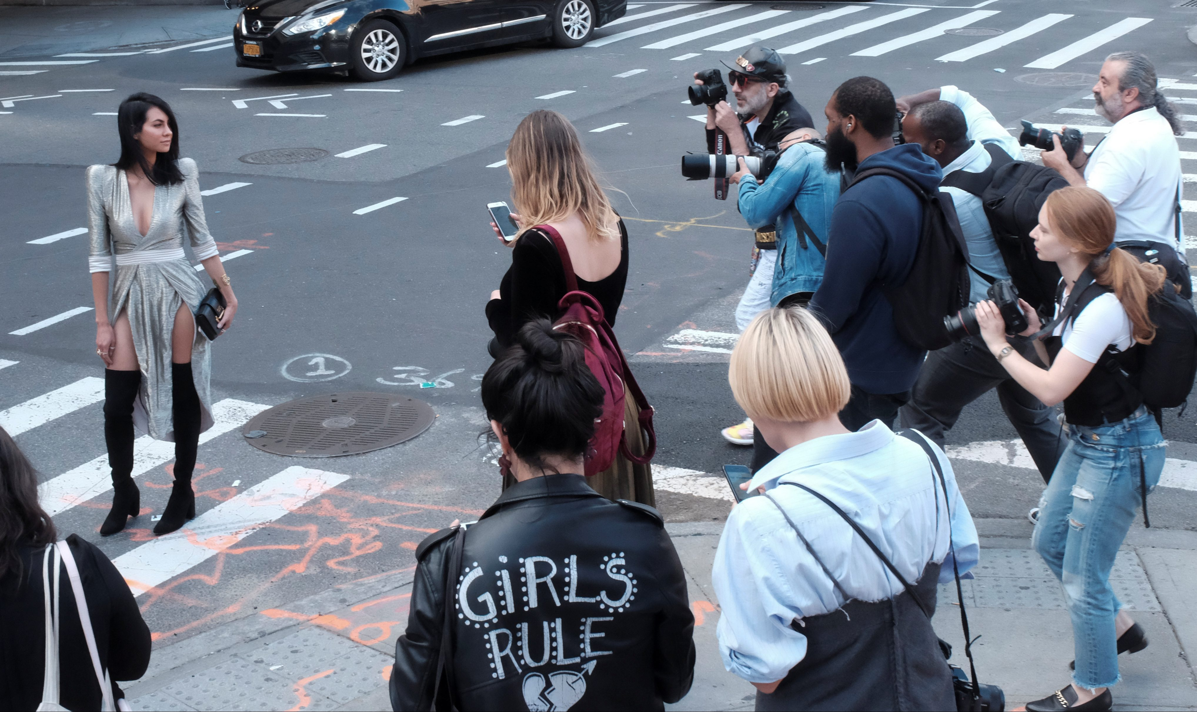 Photographers document street style outside Skylight Clarkson Square during New York Fashion Week in the Manhattan borough of New York City, U.S., September 8, 2017. REUTERS/Brenna Weeks - RC1A6A74BFD0