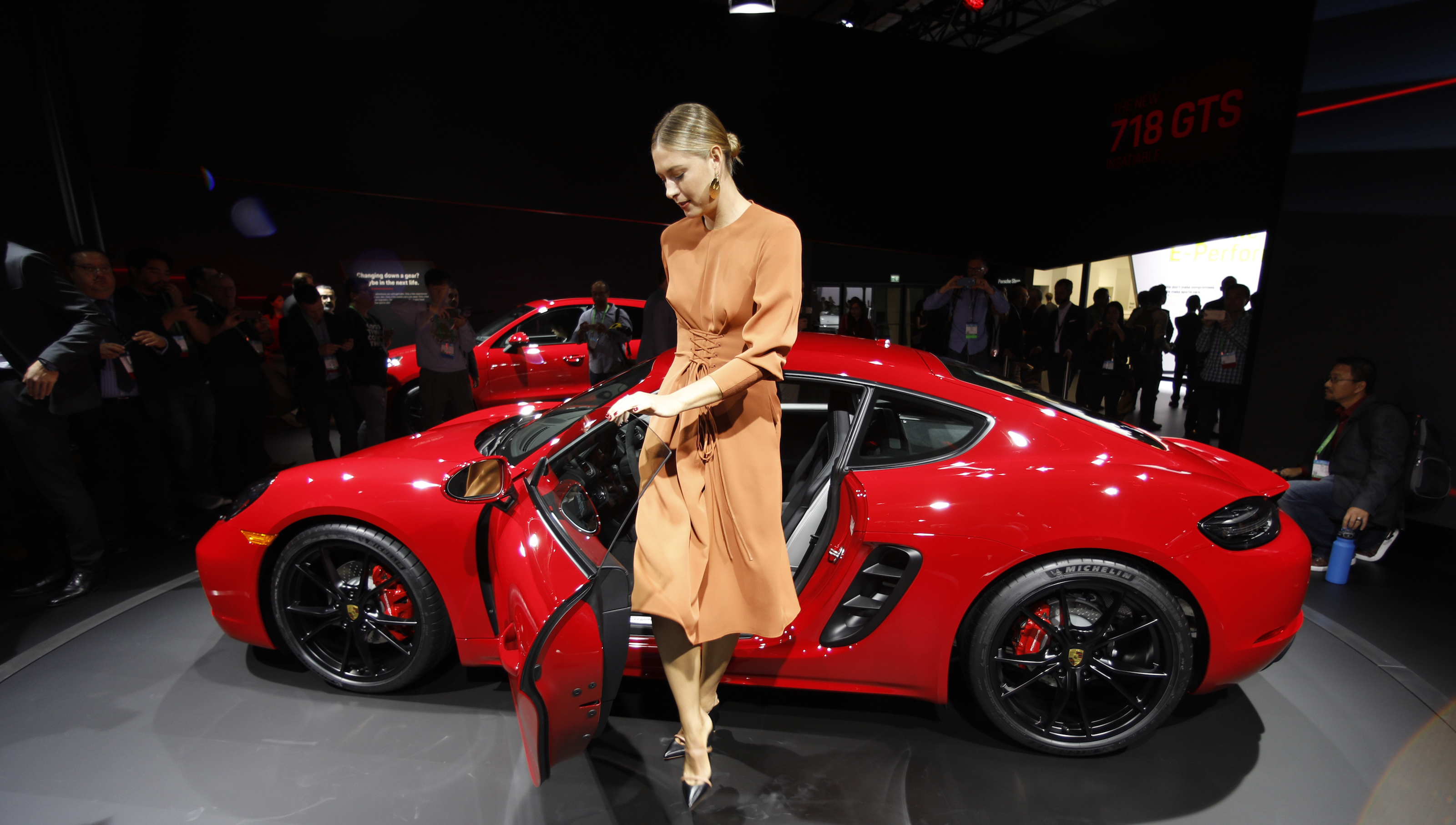 Professional tennis player Maria Sharapova poses next to a Porsche 718 Cayman GTS at the Los Angeles Auto Show in Los Angeles, California U.S. November 29, 2017. REUTERS/Mike Blake - HP1EDBT1JJ96Z