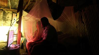Julian and his wife Zulma watch television powered with the help of a generator after Hurricane Maria damaged the electrical grid in September, in Dorado