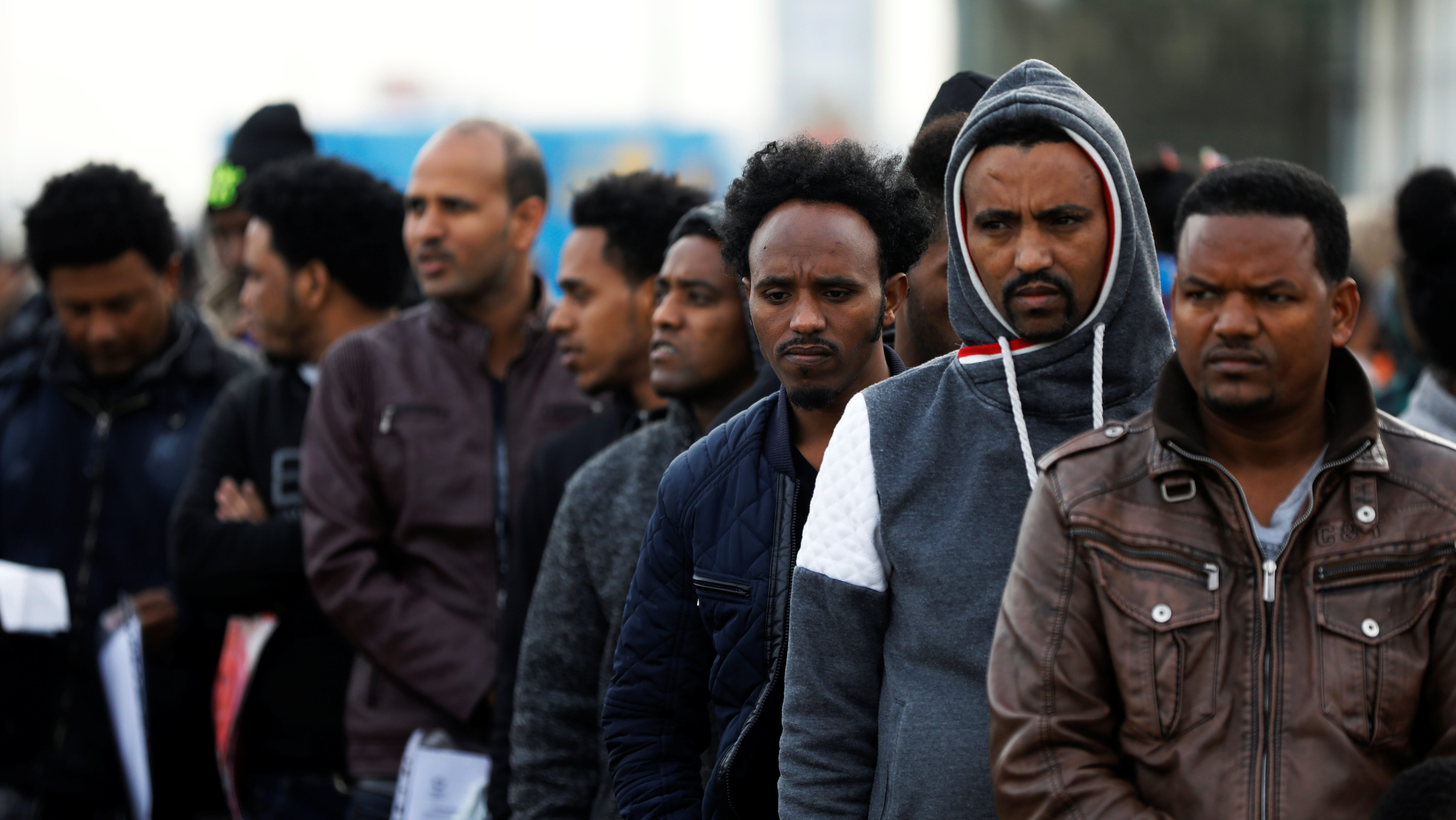 African migrants wait in line for the opening of the Population and Immigration Authority office in Bnei Brak, Israel February 4, 2018. Picture taken February 4, 2018.
