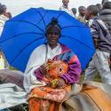 A refugee from the Democratic Republic of Congo sits with her belongings near the United Nations High Commissioner for Refugees (UNHCR) offices in Kiziba refugee camp in Karongi District, Rwanda February 21, 2018.