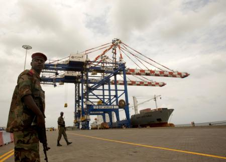 FILE PHOTO: A Djibouti policeman stands guard during the opening ceremony of Dubai-based port operator DP World's Doraleh container terminal in Djibouti port February 7, 2009.