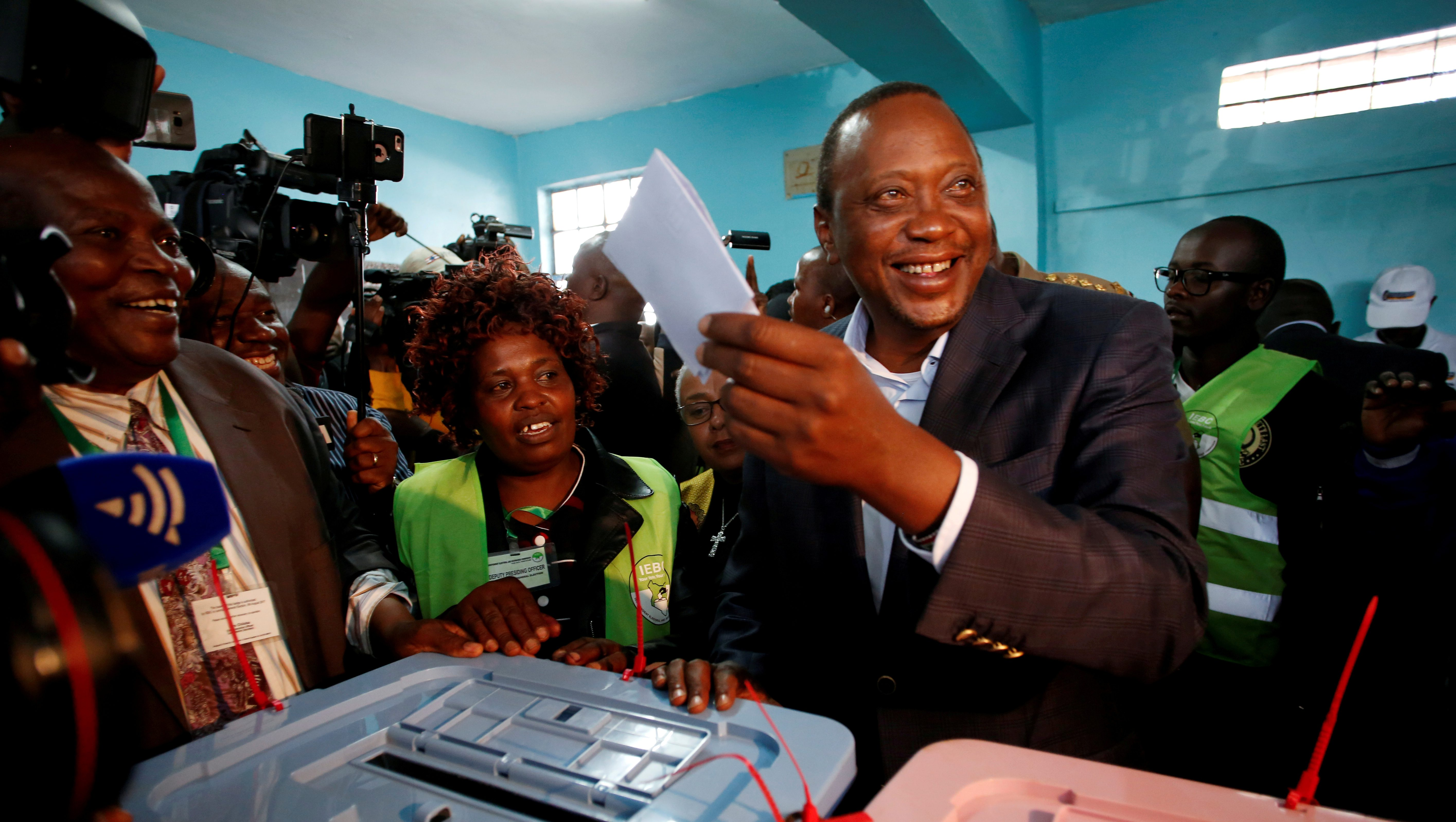 FILE PHOTO: Kenya's President Uhuru Kenyatta casts his ballot inside a polling station in his hometown of Gatundu in Kiambu county, Kenya August 8, 2017.    To match Special Report KENYA-POLICE/WATCHDOG