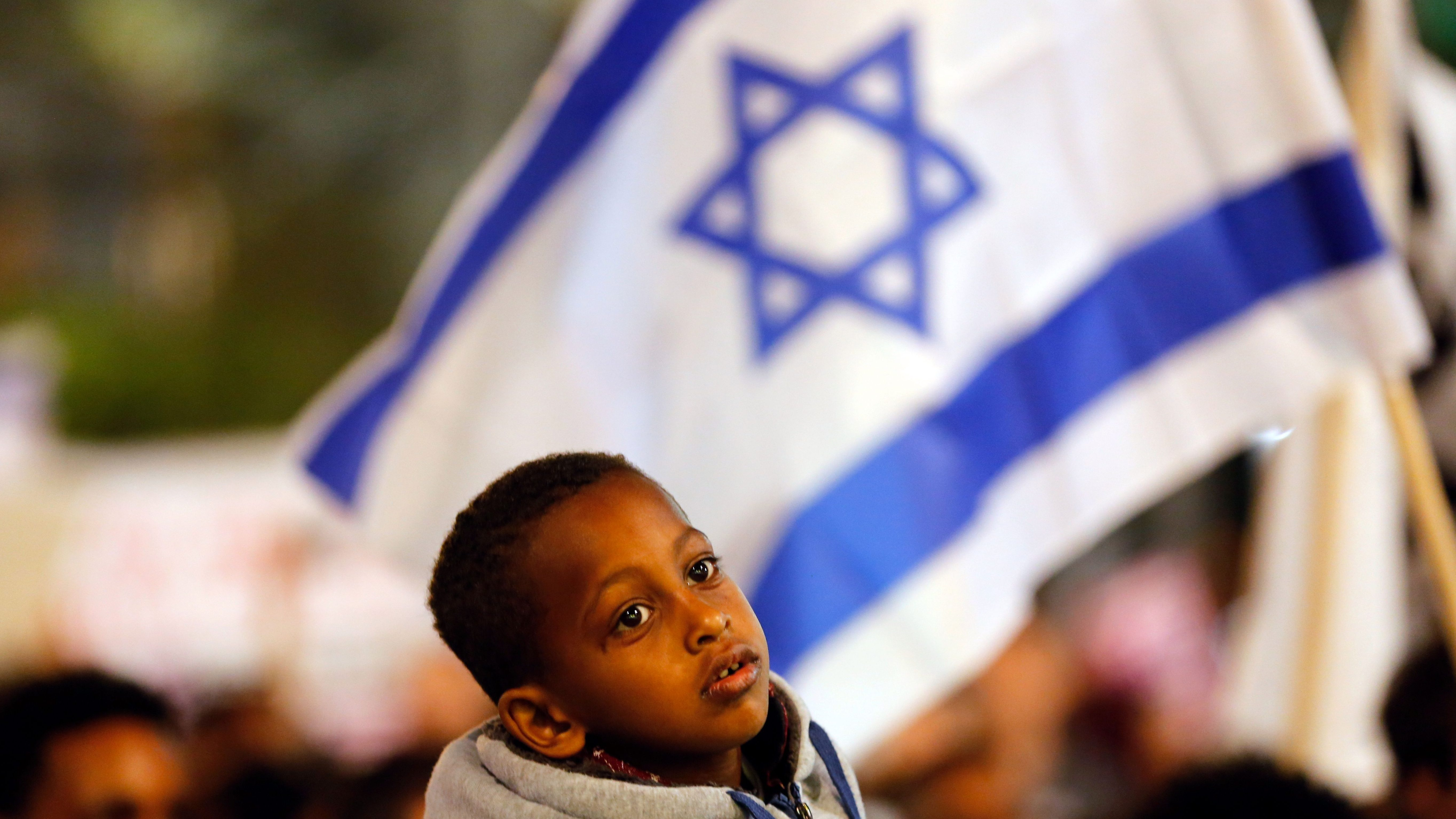 A boy takes part in a protest against the Israeli government's plan to deport African migrants, in Tel Aviv, Israel March 24, 2018.